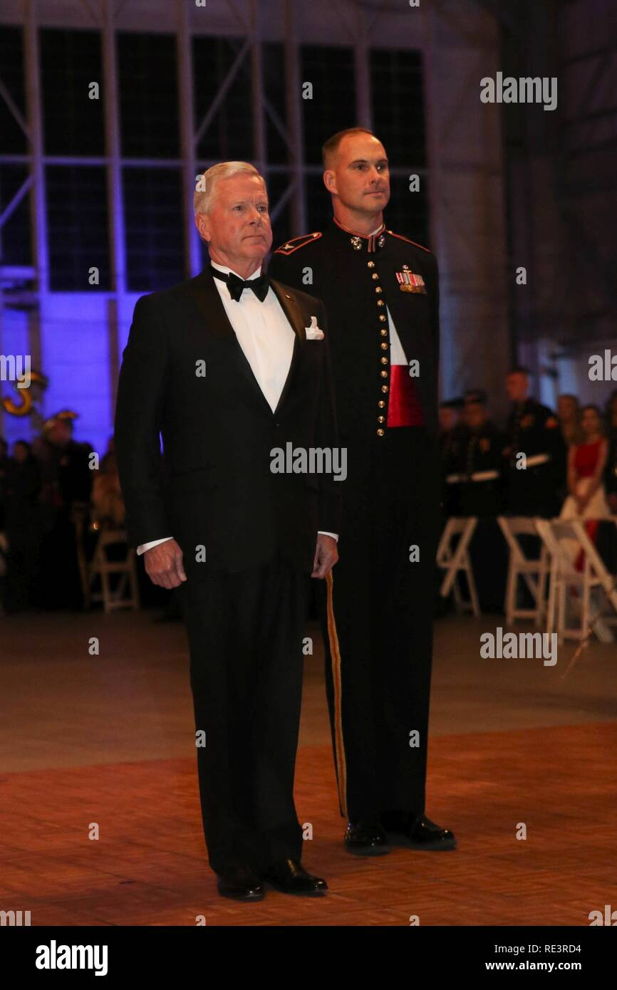 Left, retired Gen. James F. Amos and Col Robert Cooper, right, stand at attention as the U.S. and Marine Corps's Colors are retired during a ceremony at the Marine Aircraft Group 31's Marine Corps Birthday Ball, aboard MCAS Beaufort, Nov. 9. Amos was the Commanding Officer of MAG-31 and the 35 Commandant of the Marine Corps. Cooper is the current Commanding Officer of MAG-31. Stock Photo