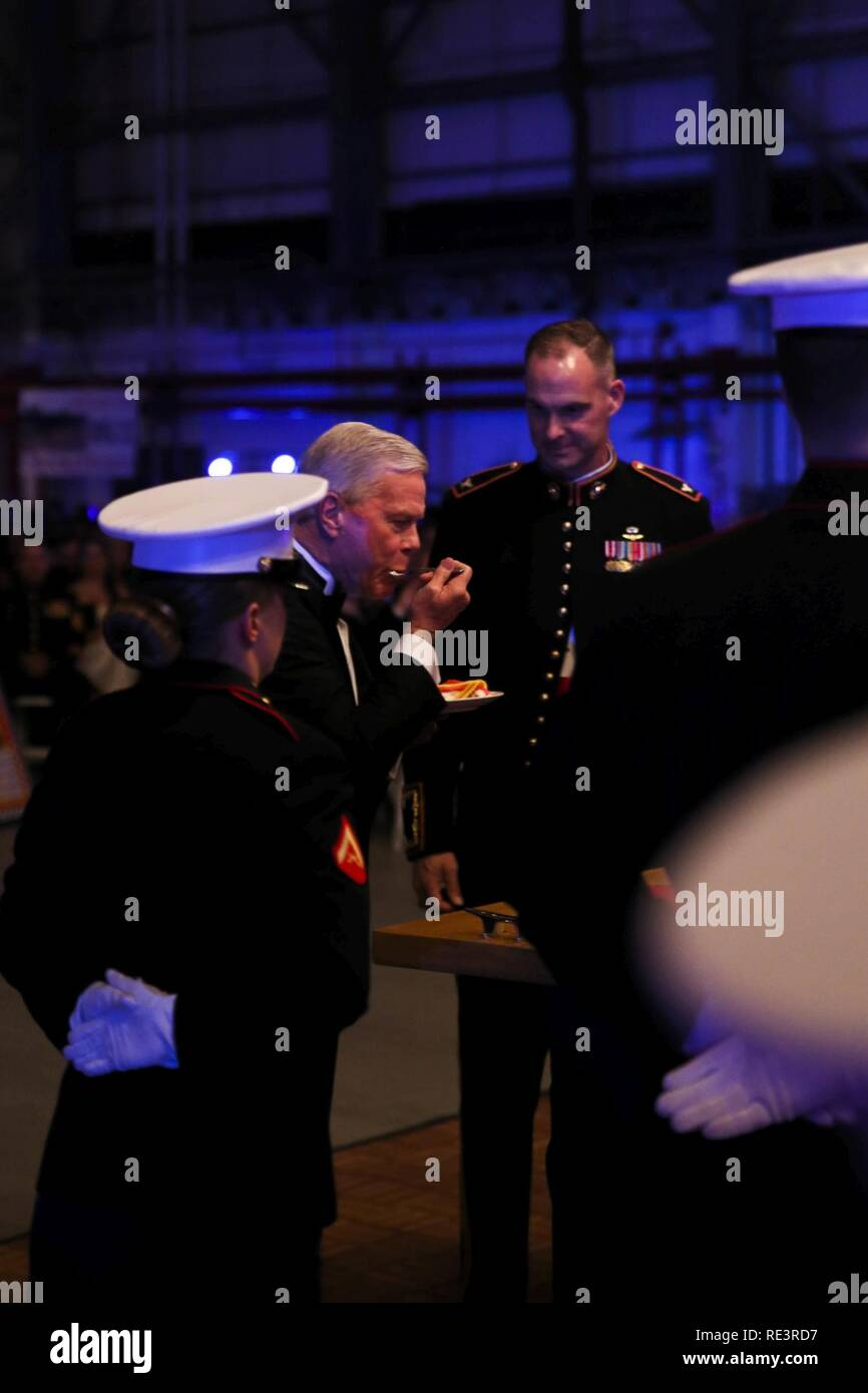 Retired Gen. James F. Amos eats the first bight of cake as the guest of honor at Marine Aircraft Group 31's Marine Corps Birthday Ball, aboard MCAS Beaufort, Nov. 9. According to Marine Corps tradition, the guest of honor at ball eats the first bite of the birthday cake. Amos was the 35 Commandant of the Marine Corps. Stock Photo