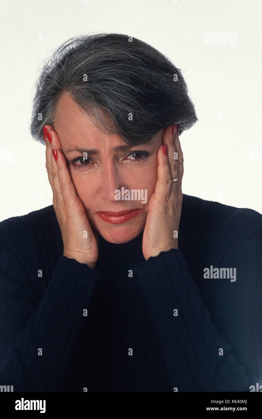 Sad Senior Woman Looking at Camera, USA - Stock Image