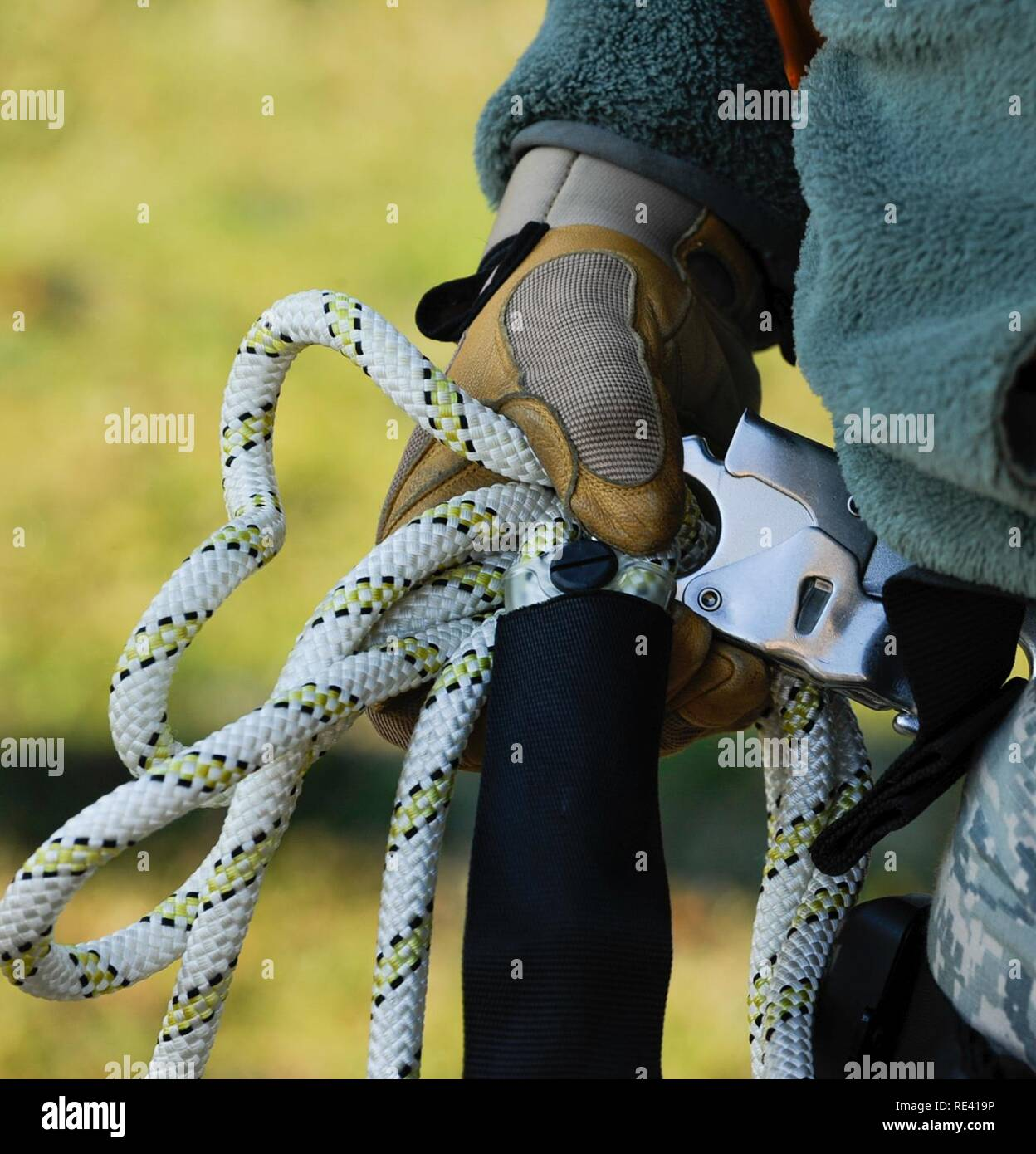 Senior Airman Mathew Godec, 86th Operations Support Squadron airfield systems technician, bundles excess rope at Ramstein Air Base, Germany, Nov. 14, 2016. This equipment is used to assist 86th OSS Airmen in climbing air traffic control radio antennas across the base to keep the airfield open and the Instrument Landing Systems in compliance with the Federal Aviation Administration and International Civil Aviation Organization standards. - Stock Image