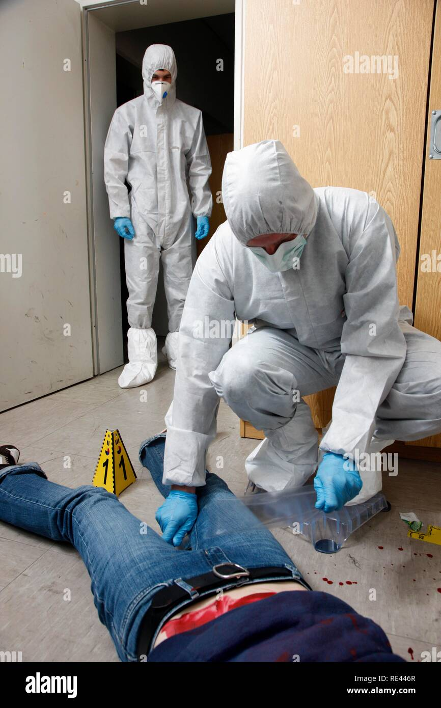 Traces of fibres and micro traces are secured with large duct tape, officers of the C.I.D., the Criminal Investigation Stock Photo
