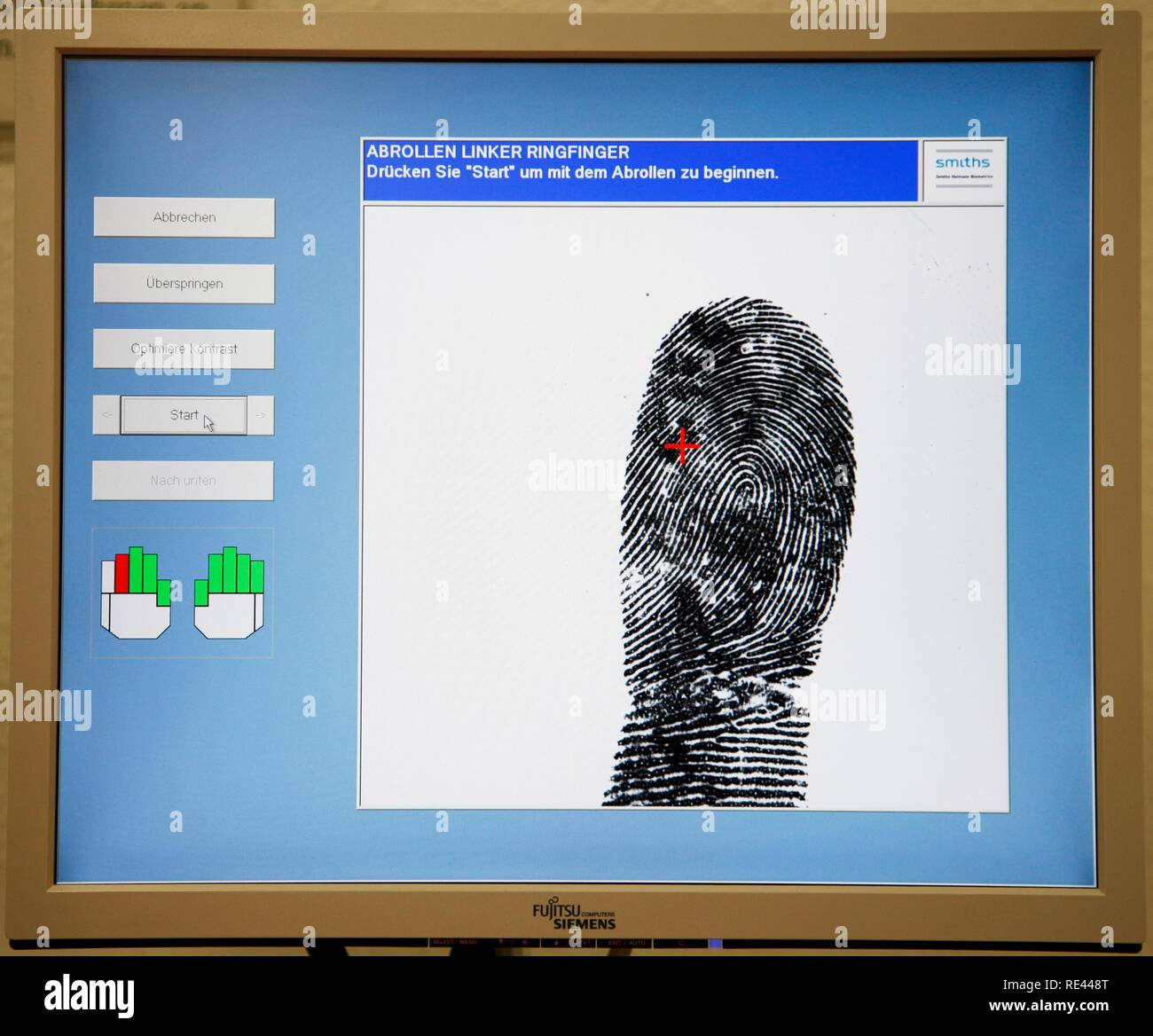 Fingerprints and handprints being recorded by digital scanner, physical identification of a suspect in a criminal investigation - Stock Image