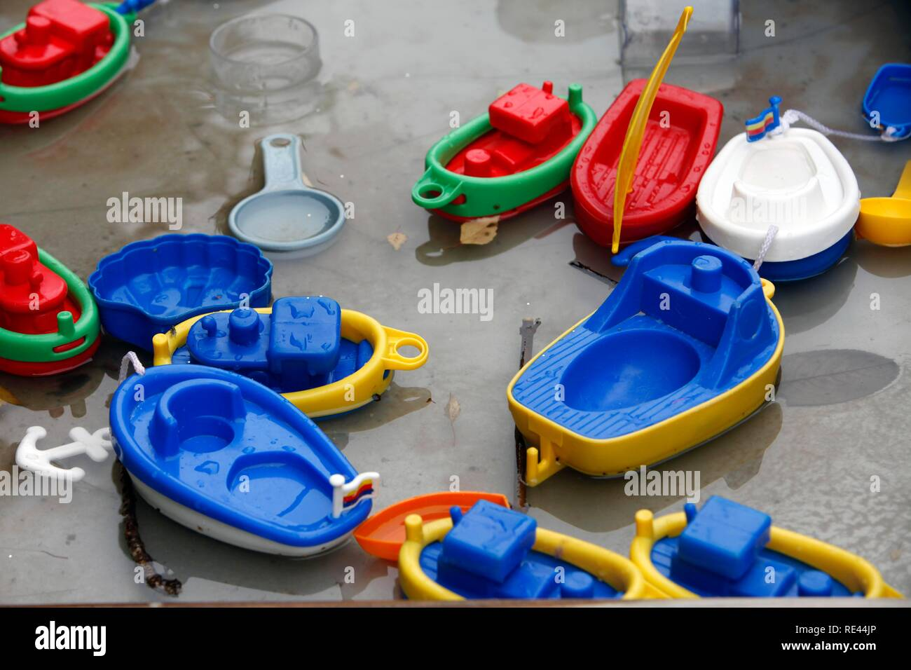 Boats, ships, plastic children's toys on a water playground Stock Photo
