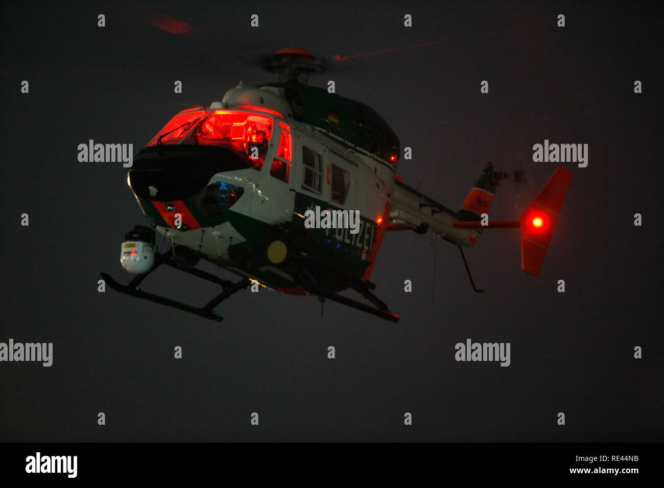 Patrol helicopter with night flying capability, image intensifier, infrared camera, night mission, police flying squadron NRW - Stock Image