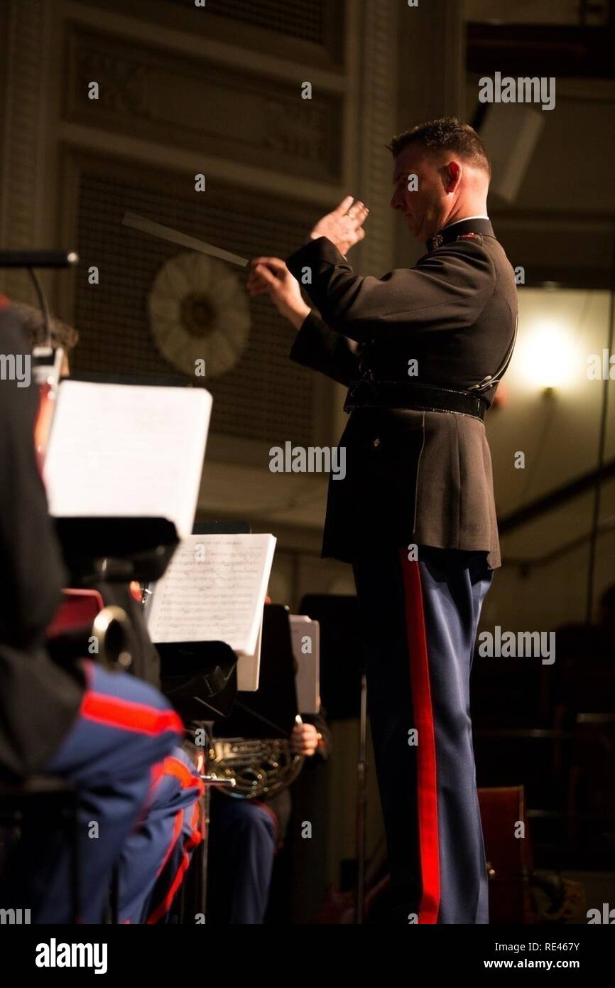 Chief Warrant Officer 3 Michael J. Smith, band officer of Marine Corps Band New Orleans, conducts the band during a concert for local residents to celebrate the Marine Corps Reserve Centennial at Plymouth Memorial Hall, in Boston, Nov. 11, 2016. Marine Forces Reserve is commemorating 100 years of rich history, heritage and espirit de corps across the U.S. This concert was part of a series of events to recognize the long standing bond between Massachusetts and the Marine Corps Reserve. - Stock Image