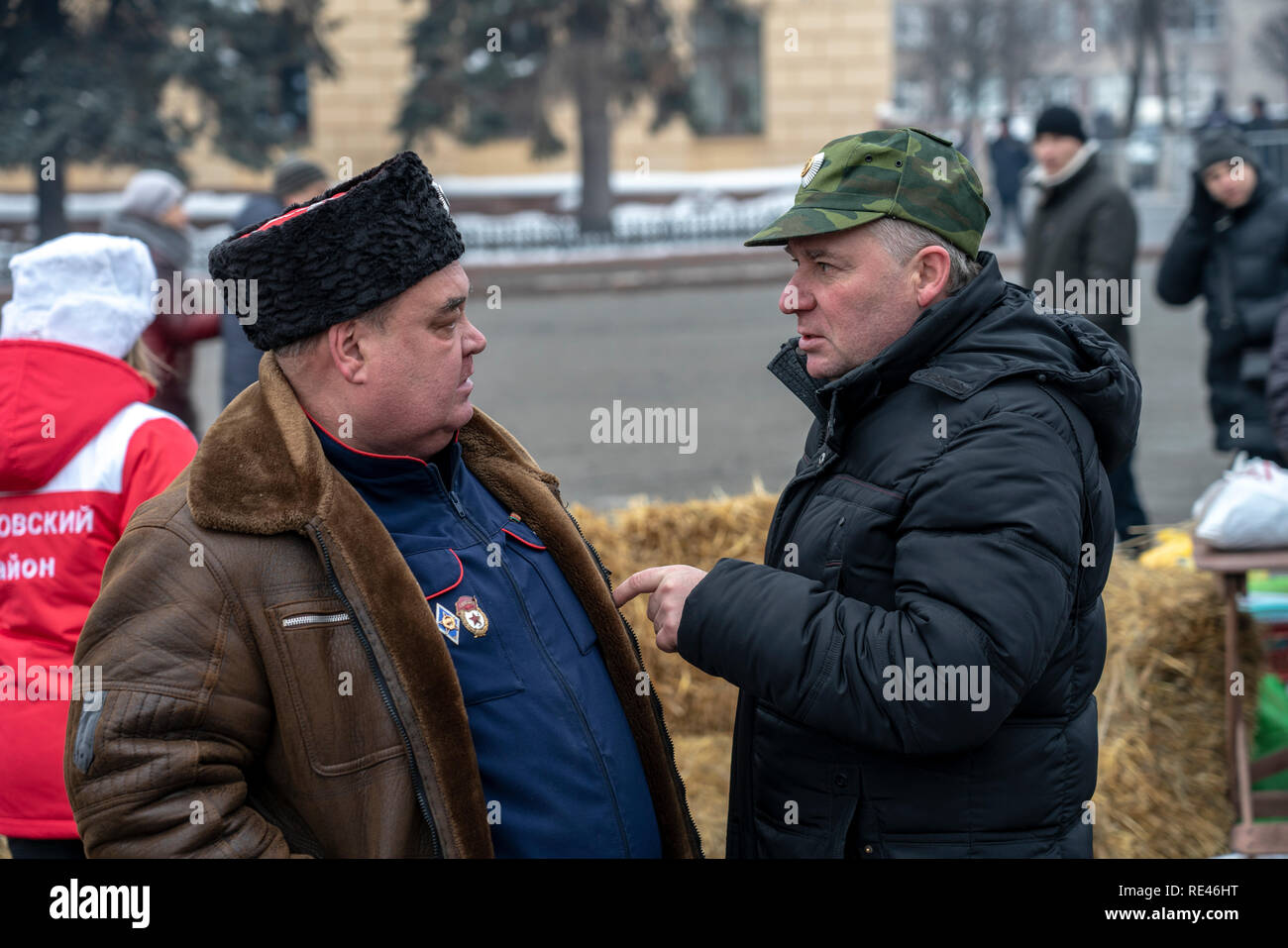 Russian Cossacks lively conversation during the festival - Stock Image