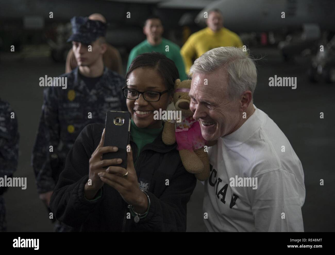 ARABIAN GULF (Nov. 24, 2016) Secretary of the Navy Ray Mabus poses for photos with Sailors during a Thanksgiving Day visit aboard the aircraft carrier USS Dwight D. Eisenhower (CVN 69) (Ike). Ike's culinary specialists prepared more than 4,950 pounds of turkey, 1,050 pounds of ham, 1,200 pounds of beef tenderloin, 648 pounds of shrimp cocktail, 7,000 portions of mashed potatoes, 400 pies and 200 cheesecakes for the ship's Thanksgiving meal. Ike and its carrier strike group are deployed in support of Operation Inherent Resolve, maritime security operations and theater security cooperation effor - Stock Image