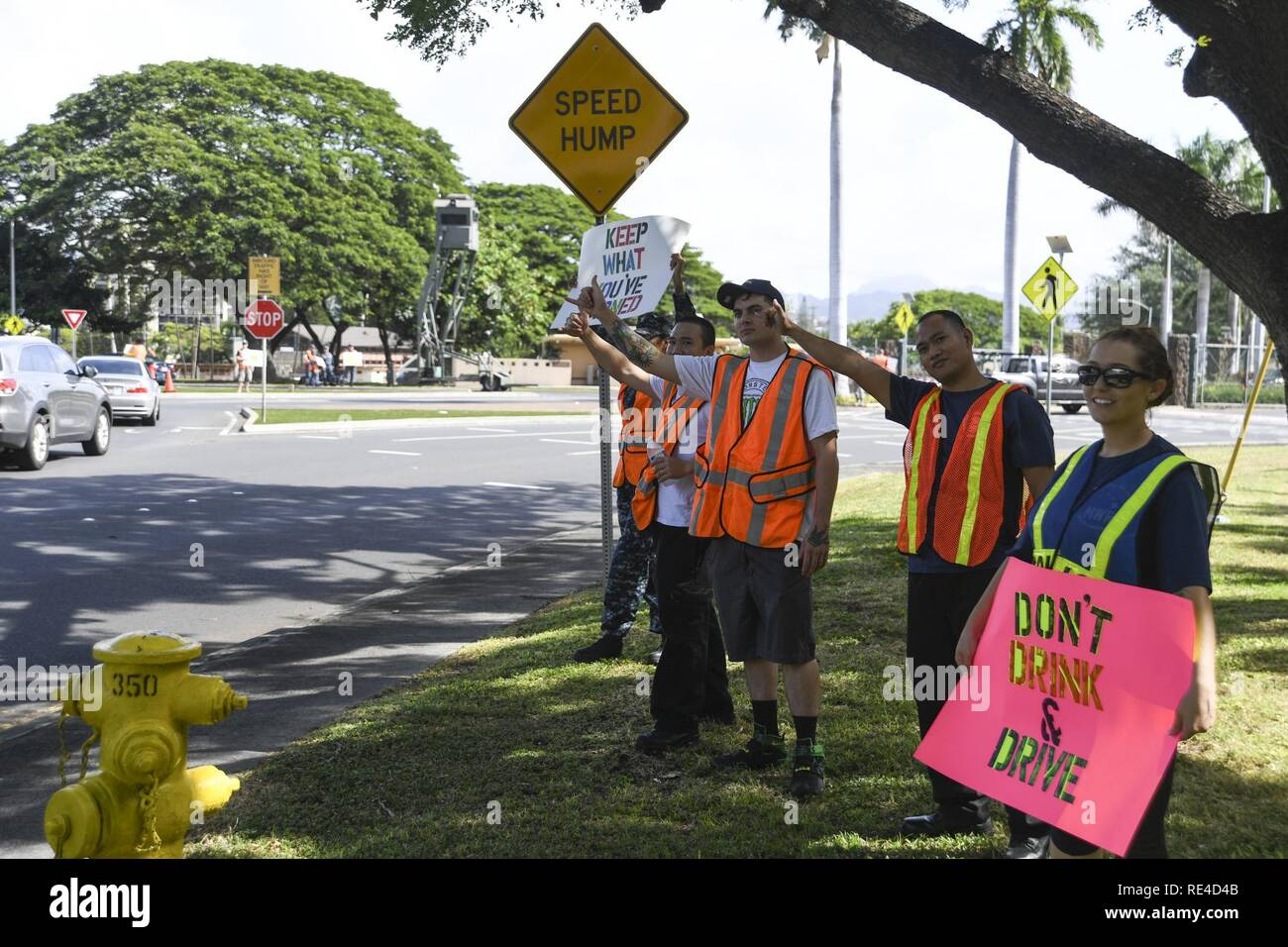 PEARL HARBOR (Nov. 23, 2016) Service members rally at the Joint Base Pearl Harbor-Hickam gates to remind drivers to not drink and drive, Nov. 23. Petty Officer 2nd Class Shaylee Stewart organized the event partnering with Master Chief Suz Whitman, U.S. Pacific Fleet Master Chief, and JBPHH organizations Coalition of Sailors Against Destructive Decisions, Airmen Against Drinking and Driving, Chief Petty Officer 365 and the command's Drug and Alcohol Program advisors. Stock Photo