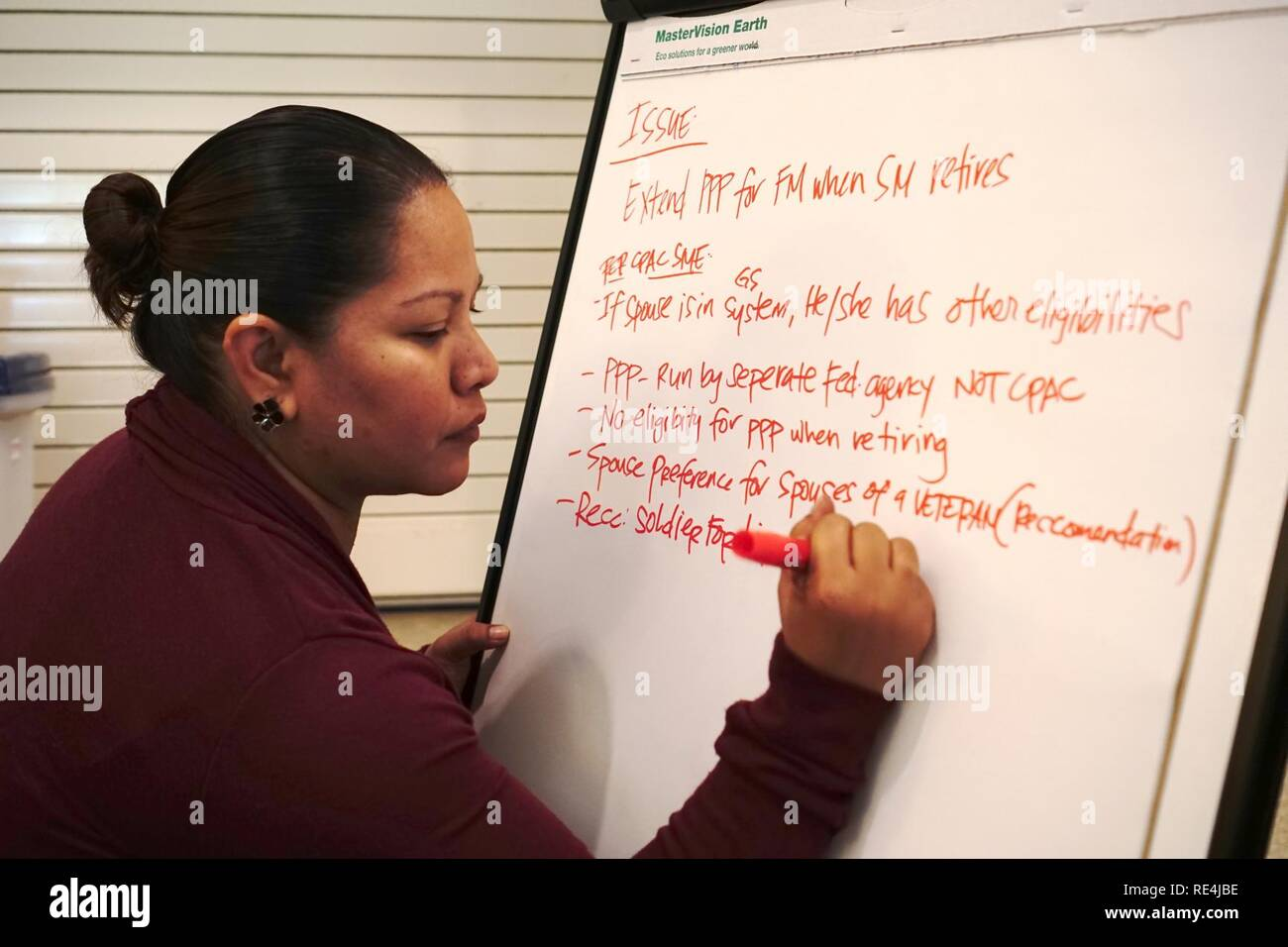 Jeanne Sablan transcribes possible solutions to concerns brought up by delegates at the Army Family Action Plan conference held at the Nehelani, Nov. 15. Stock Photo