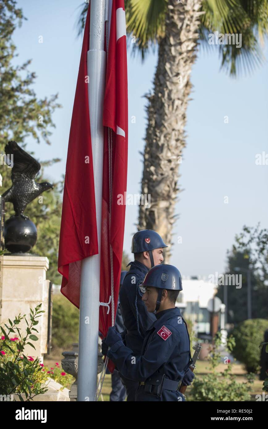 A member of the 10th Tanker Base Command honor guard lowers a