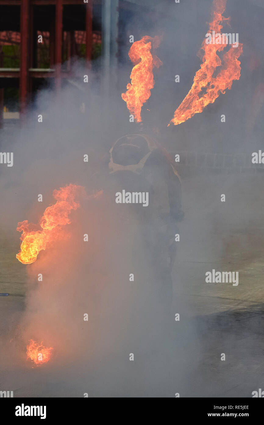 Bucharest, Romania - May 13, 2011: Professional motorcycle rider Angyal Zoltan performes a burnout stunt with fire flames during the Romanian Tuning S - Stock Image