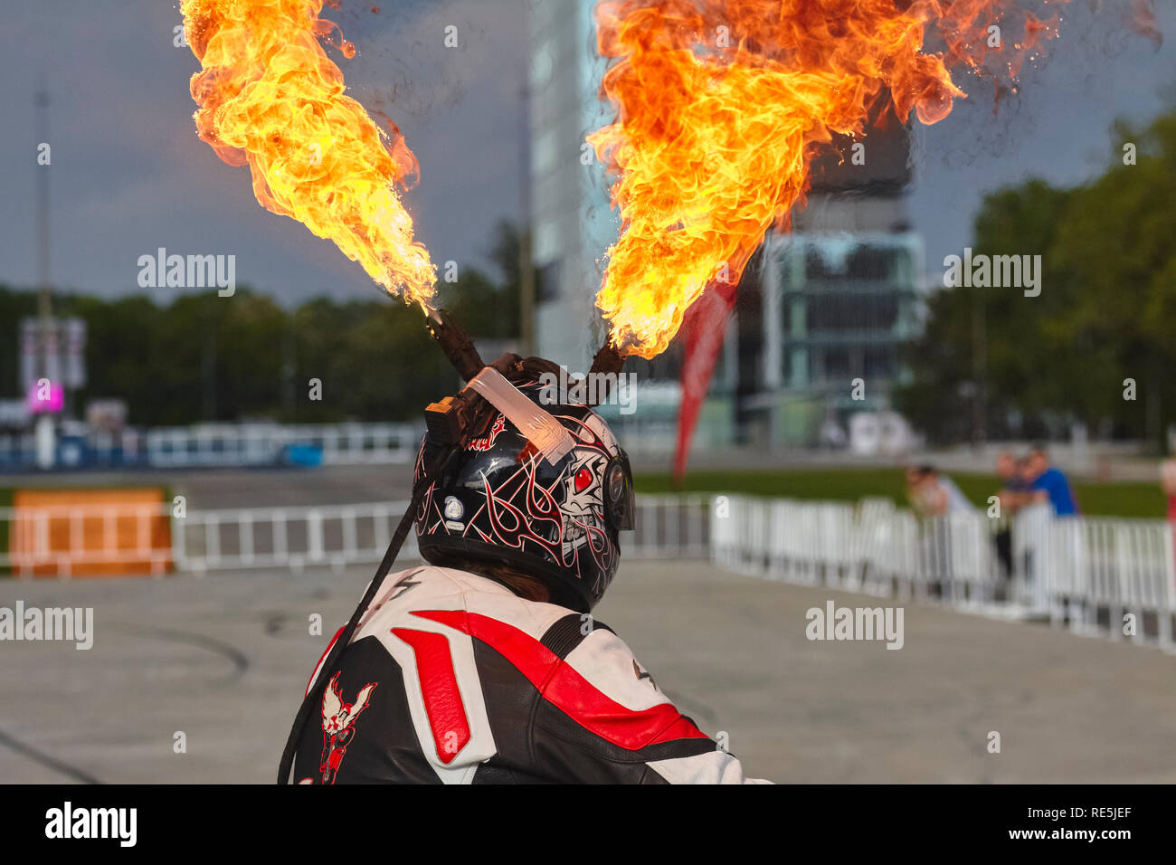 Bucharest, Romania - May 13, 2011: Motorcycle rider Angyal Zoltan wears a special customized helmet to throw fire during hist stunts at the Romanian T - Stock Image