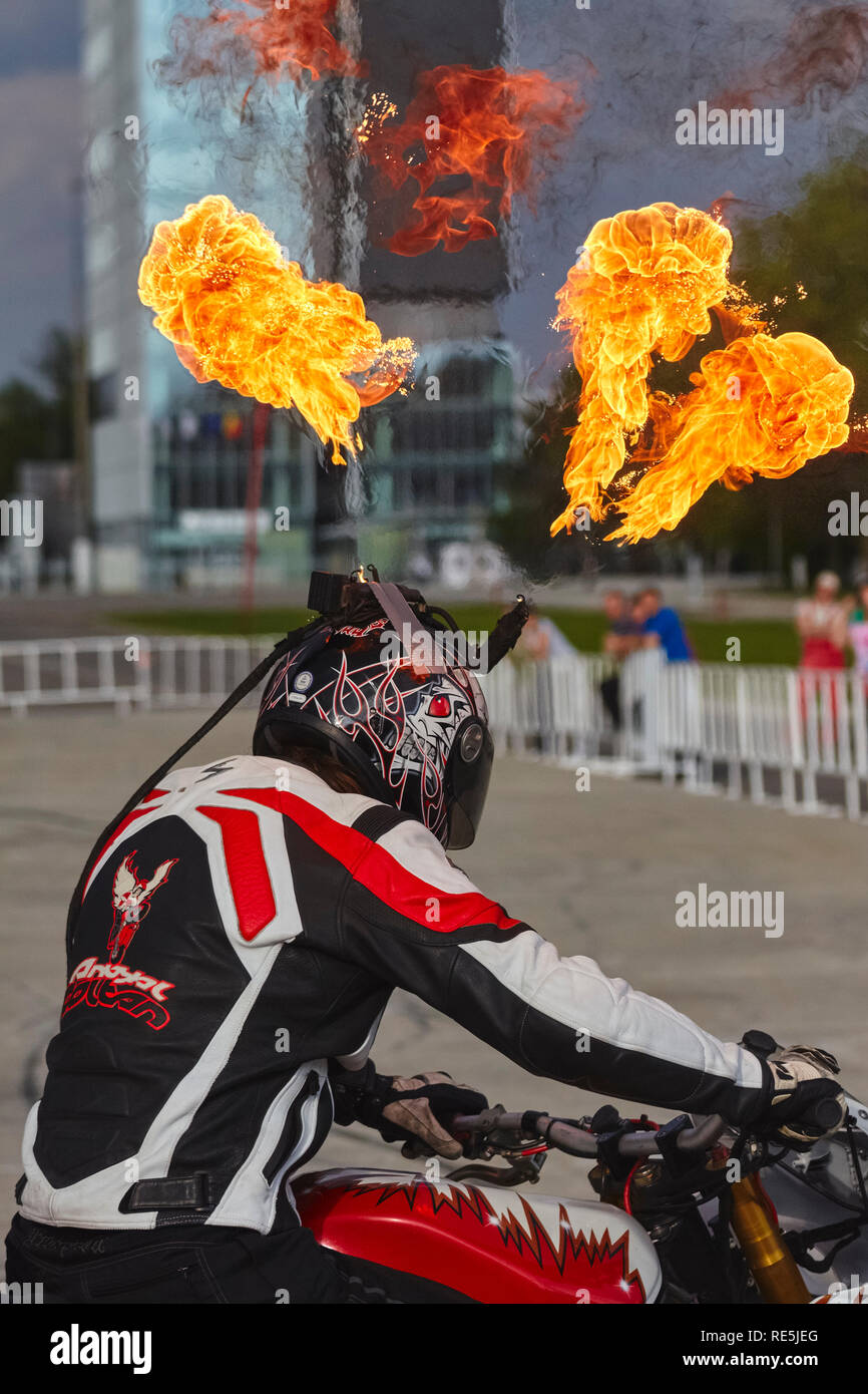 Bucharest, Romania - May 13, 2011: Motorcycle rider Angyal Zoltan wears a special customized helmet to throw fireballs during hist stunts at the Roman - Stock Image