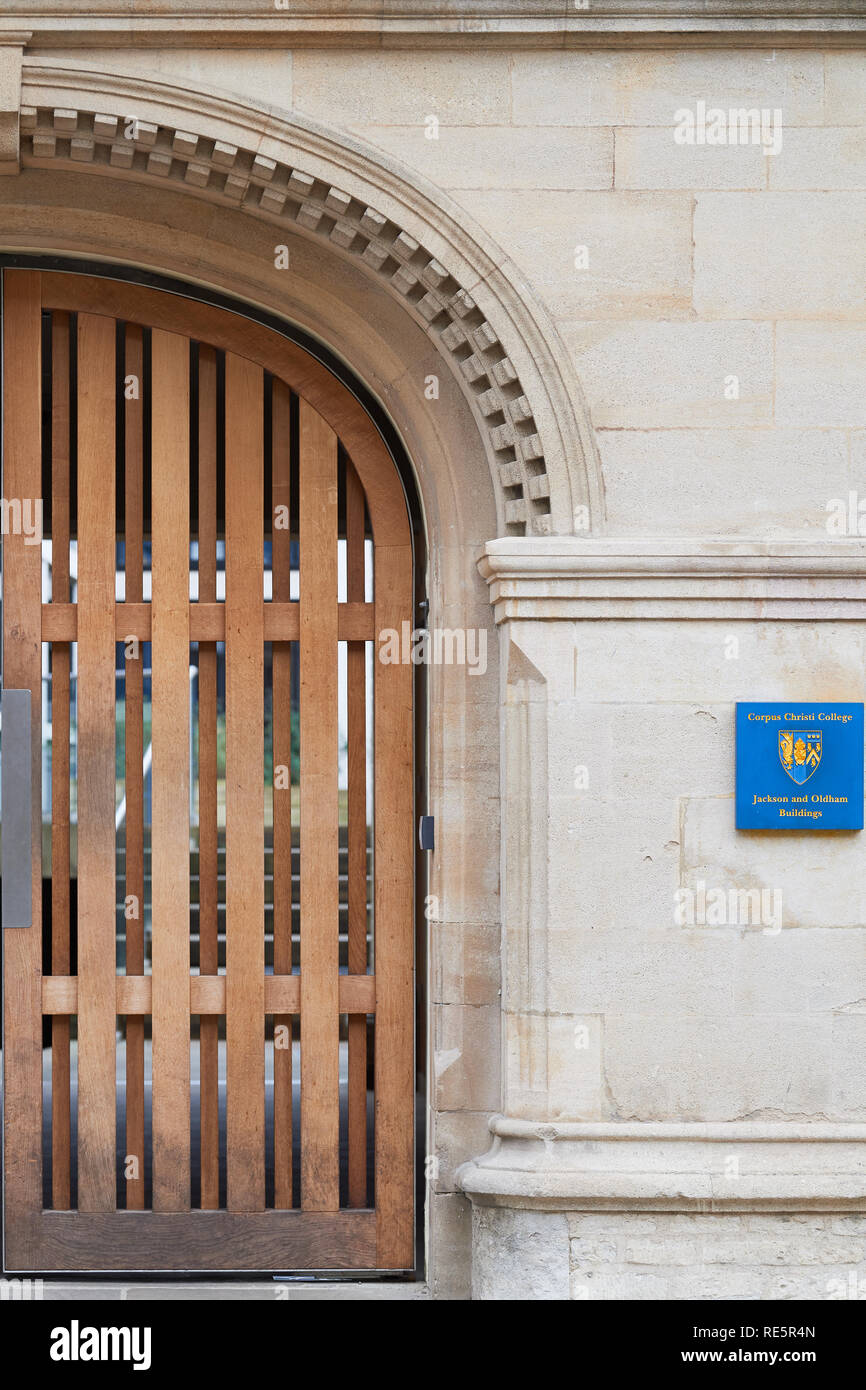Gateway entrance to the Jackson and Oldham buildings of Corpus Christi college, university of Oxford, England, with the college's badge on the wall. - Stock Image
