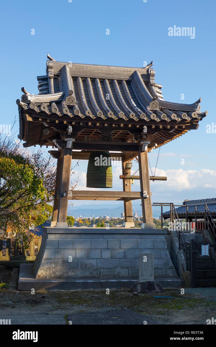 Kumamoto, Japan - November 13, 2018: Bonsho, Buddhist bell, a large temple bell at the grounds of the Honmyo-ji Temple - Stock Image