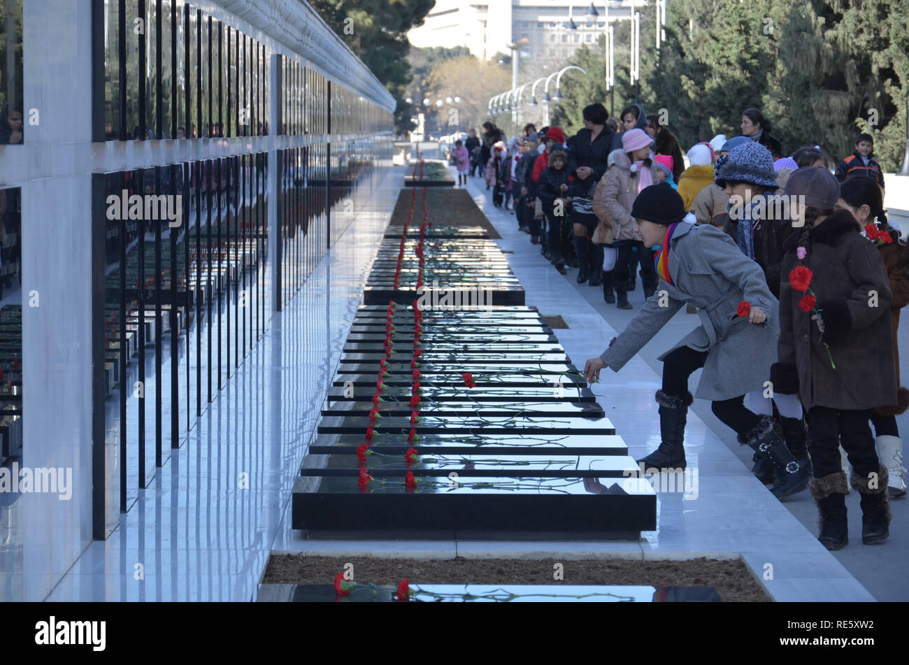 Azerbaijan, Baku, January 20, 2011. People visiting Alley of Martyrs on anniversary of 20th January tragedy when Soviet Army attacked Baku in 1990, ki Stock Photo