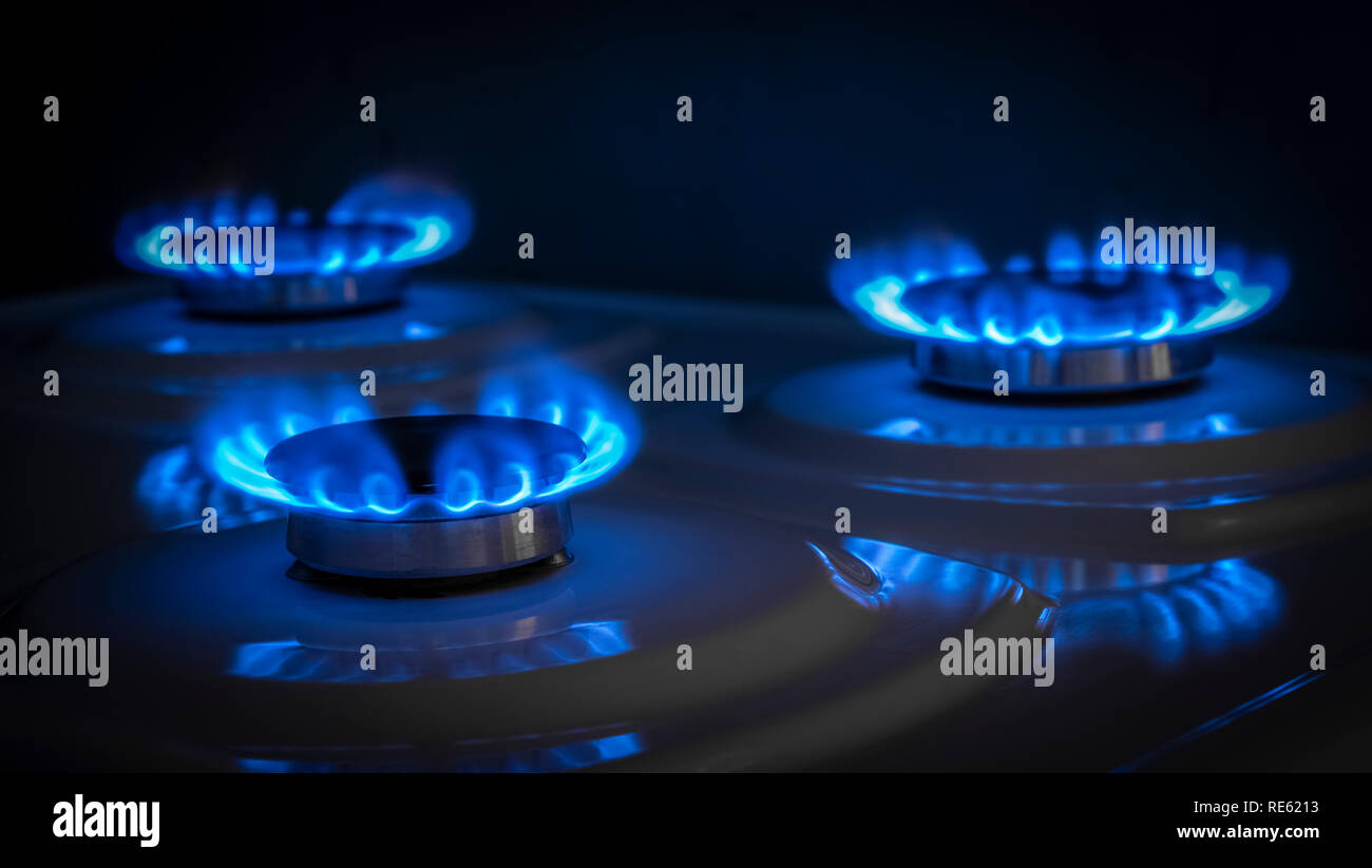 Gas burner stove in working condition close-up. - Stock Image