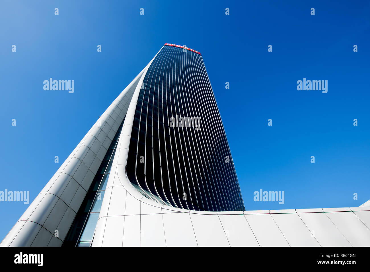 Architectural detail of the warped design of the Generali Tower by Zaha Hadid in Milan Italy in which the building twists on its central axis looking  - Stock Image
