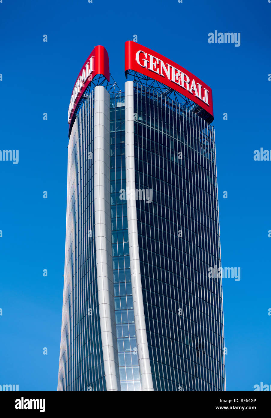 External facade of the Generali Tower in Milan Italy with its modern warped design by Zaha Hadid against a blue sky - Stock Image
