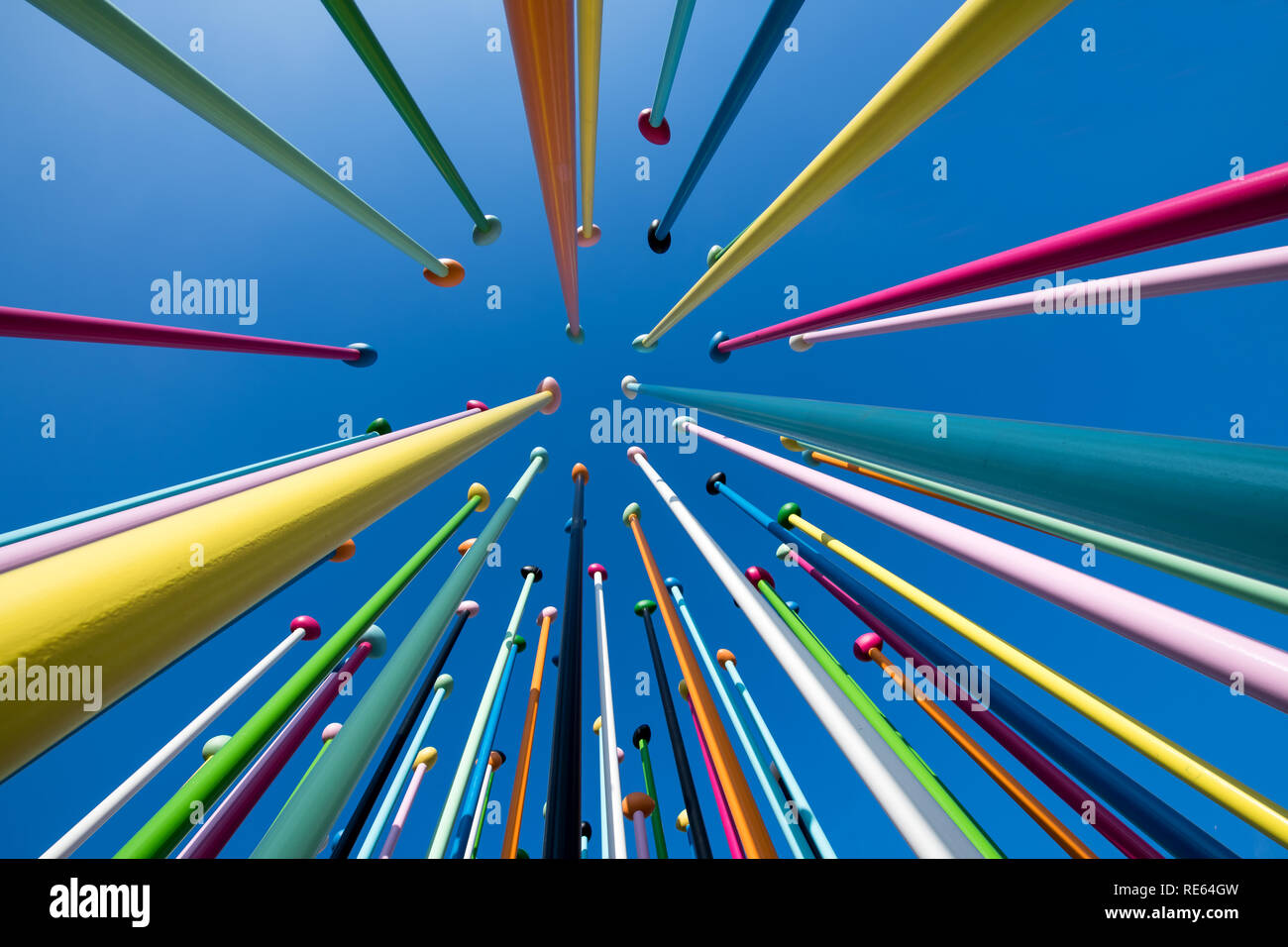 Low perspective view of the Coloris artwork, Milan by in the City Life district by Pascale Marthine Tayou against a clear blue sky - Stock Image