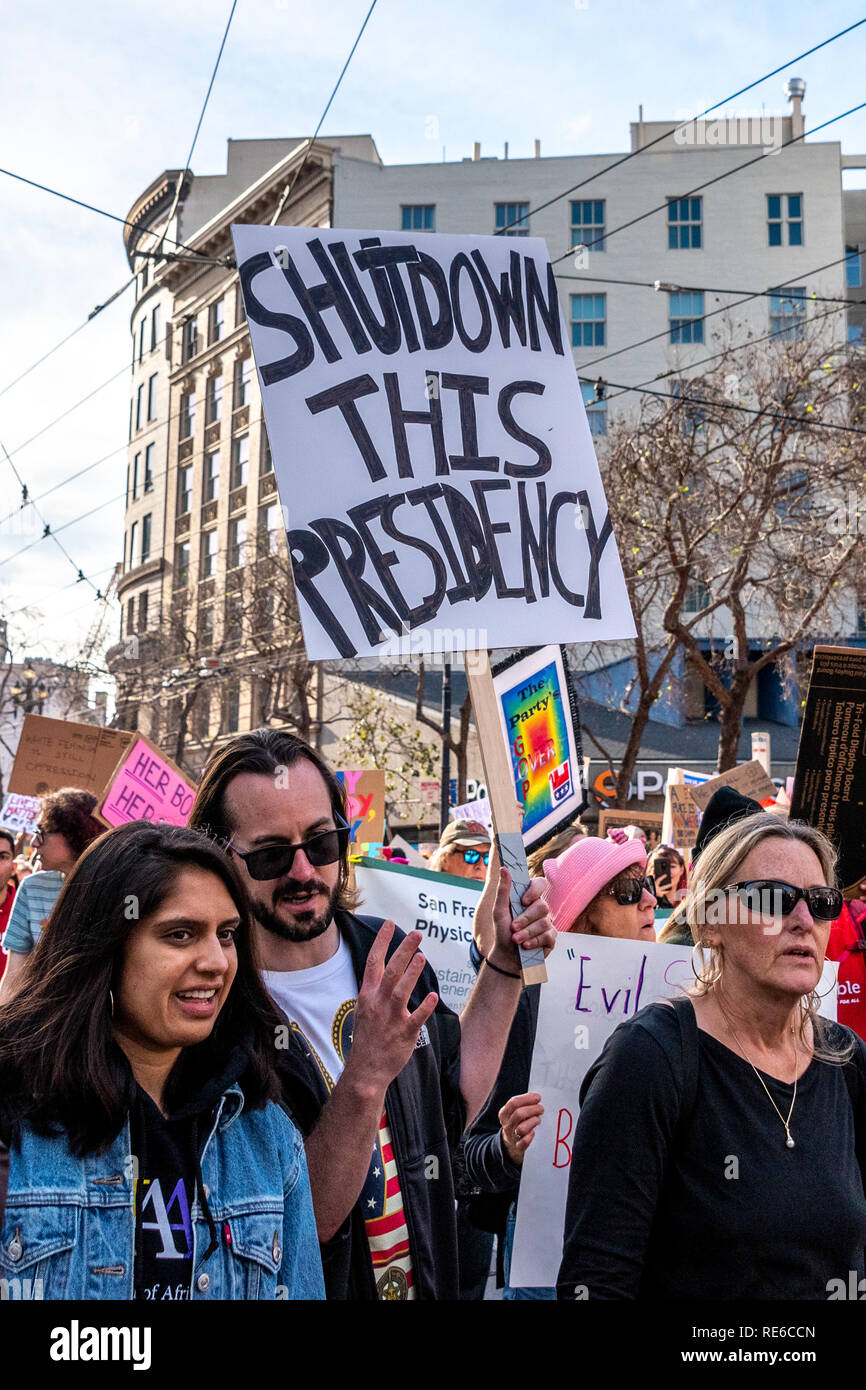 San Francisco, USA. 19th January, 2019. A man carries a anti-Trump sign reading: 'Shutdown this presidency,' in the Women's March San Francisco. Credit: Shelly Rivoli/Alamy Live News - Stock Image