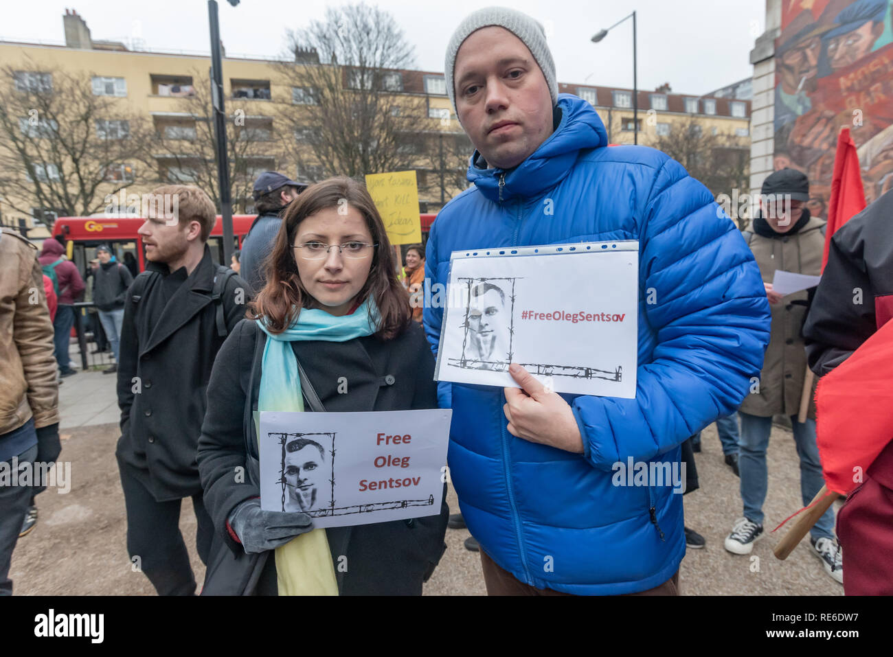 London, UK. 19th January 2019. Ukrainians hold posters of improsione anti-fascist Oleg Sentsov at the Cable St rally to oppose Stanislav Markelovracism, xenophobia, fascism and the upsurge of far-right populism and to show solidarity with Russian anti-fascists who have been arrested, framed and tortured in a brutal wave of repression.  jail for five to twenty years. The rally took place on the anniversary of the brutal murder on the street by fascists of two Russian anti-fascists Credit: Peter Marshall/Alamy Live News - Stock Image