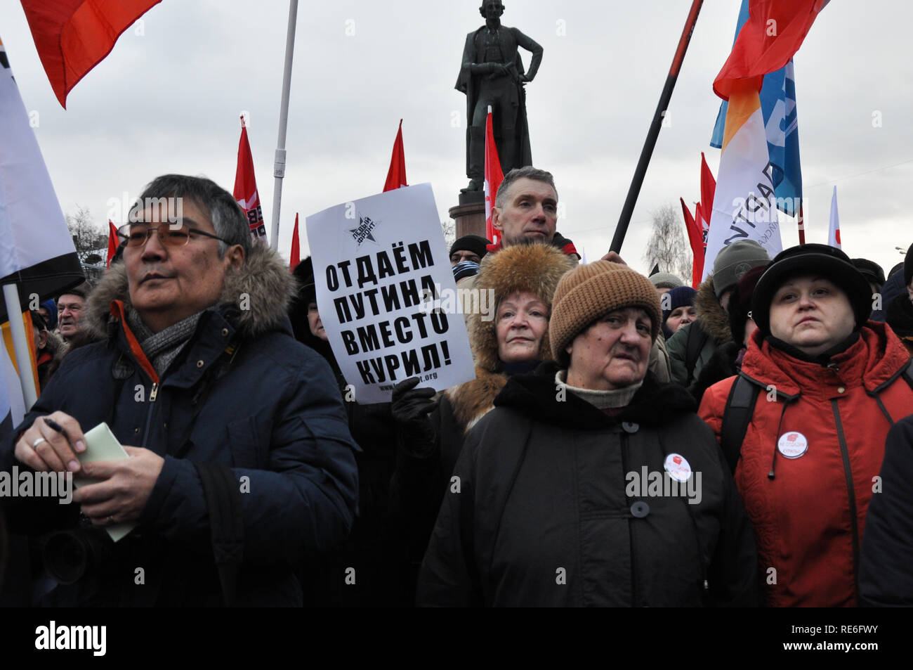 Moscow, Russia. 20th Jan, 2019. An activist is holding a sign reading 'We would give up Putin instead of the Kurils'. Hundreds from both left and right protest possible handover of contested Kuril islands (Northern territories) to Japan at a rally in central Moscow. Credit: Aleks Lokhmutov/Alamy Live News. - Stock Image
