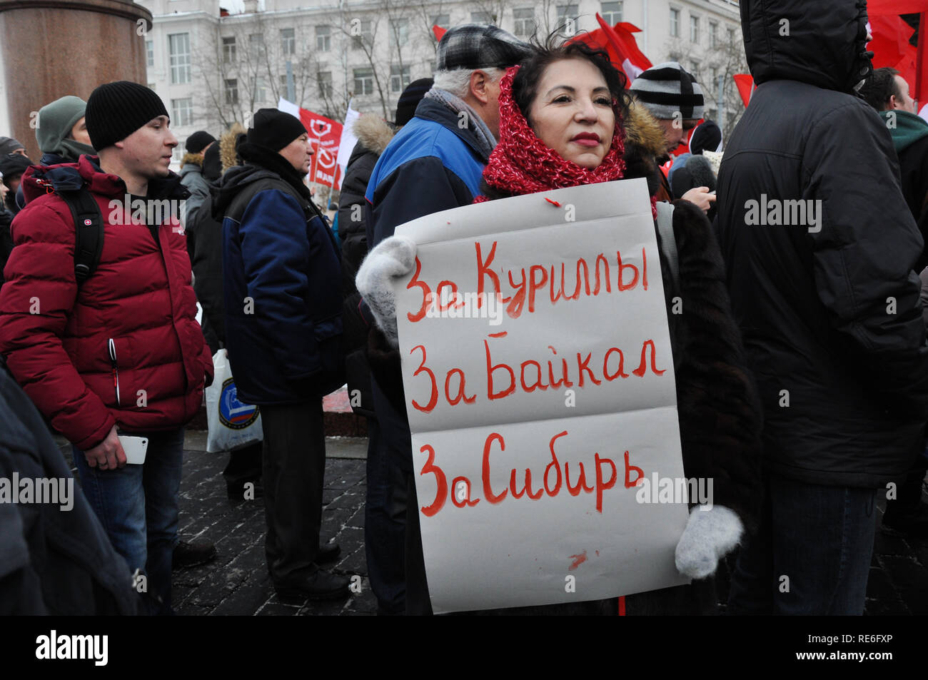 Moscow, Russia. 20th Jan, 2019. A woman is holding a sign that reads 'For the Kuril islands, for the Baikal lake, for Siberia'. Hundreds from both left and right protest possible handover of contested Kuril islands (Northern territories) to Japan at a rally in central Moscow. Credit: Aleks Lokhmutov/Alamy Live News. - Stock Image