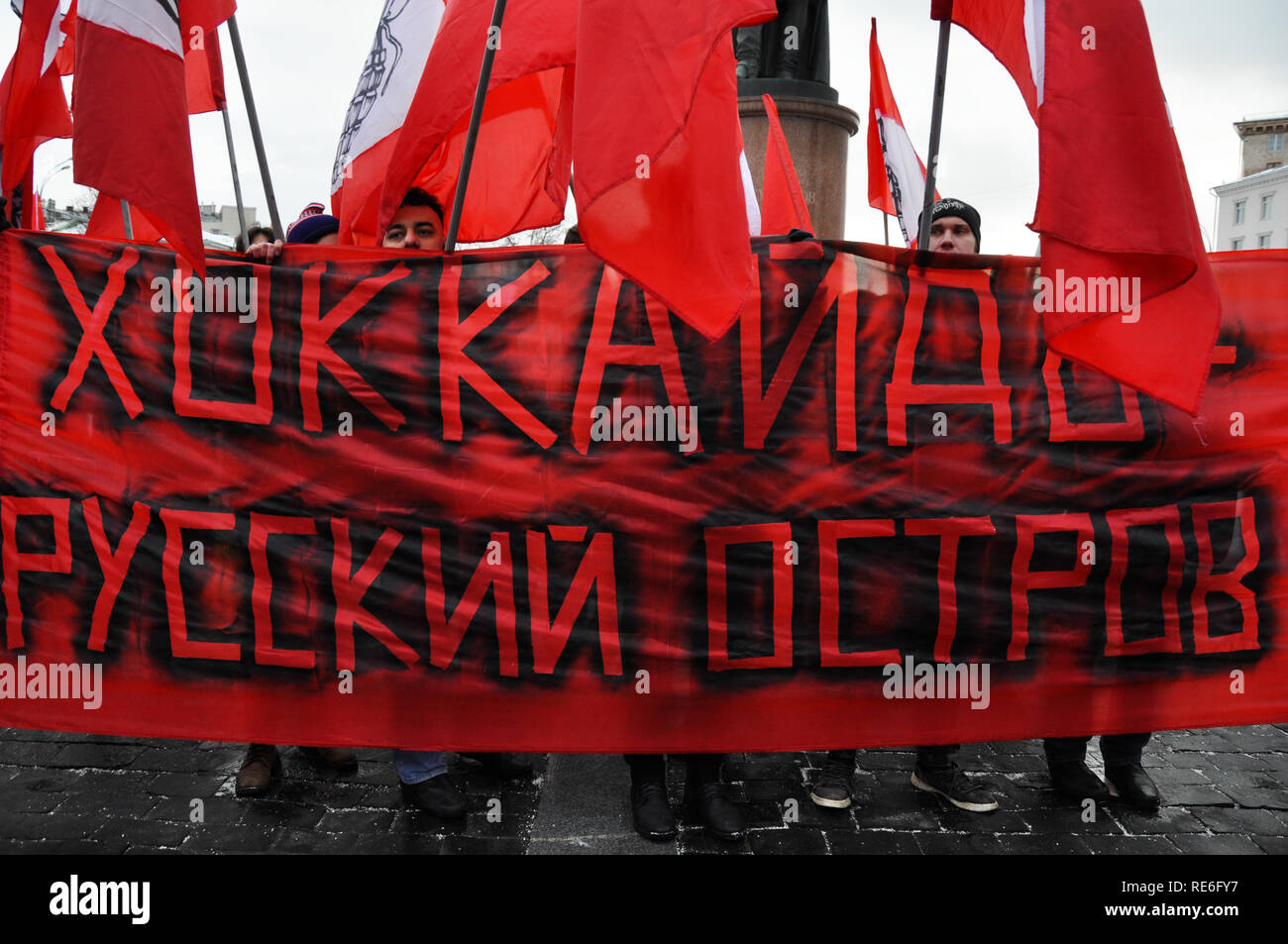 Moscow, Russia. 20th Jan, 2019. Activists are holding a banner that reads 'Hokkaido is a Russian island'. Hundreds from both left and right protest possible handover of contested Kuril islands (Northern territories) to Japan at a rally in central Moscow. Credit: Aleks Lokhmutov/Alamy Live News. - Stock Image
