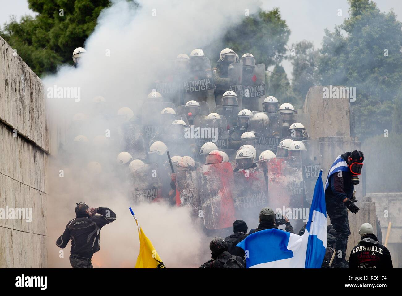 Athens, Greece. 20th Jan, 2019. Demonstrators clash with riot police during a rally outside of the Greek parliament. Thousands Greeks protest against Macedonia name deal at Syntagma square in central Athens. (Credit Image: © Aristidis VafeiadakisZUMA Wire) Credit: ZUMA Press, Inc./Alamy Live News - Stock Image