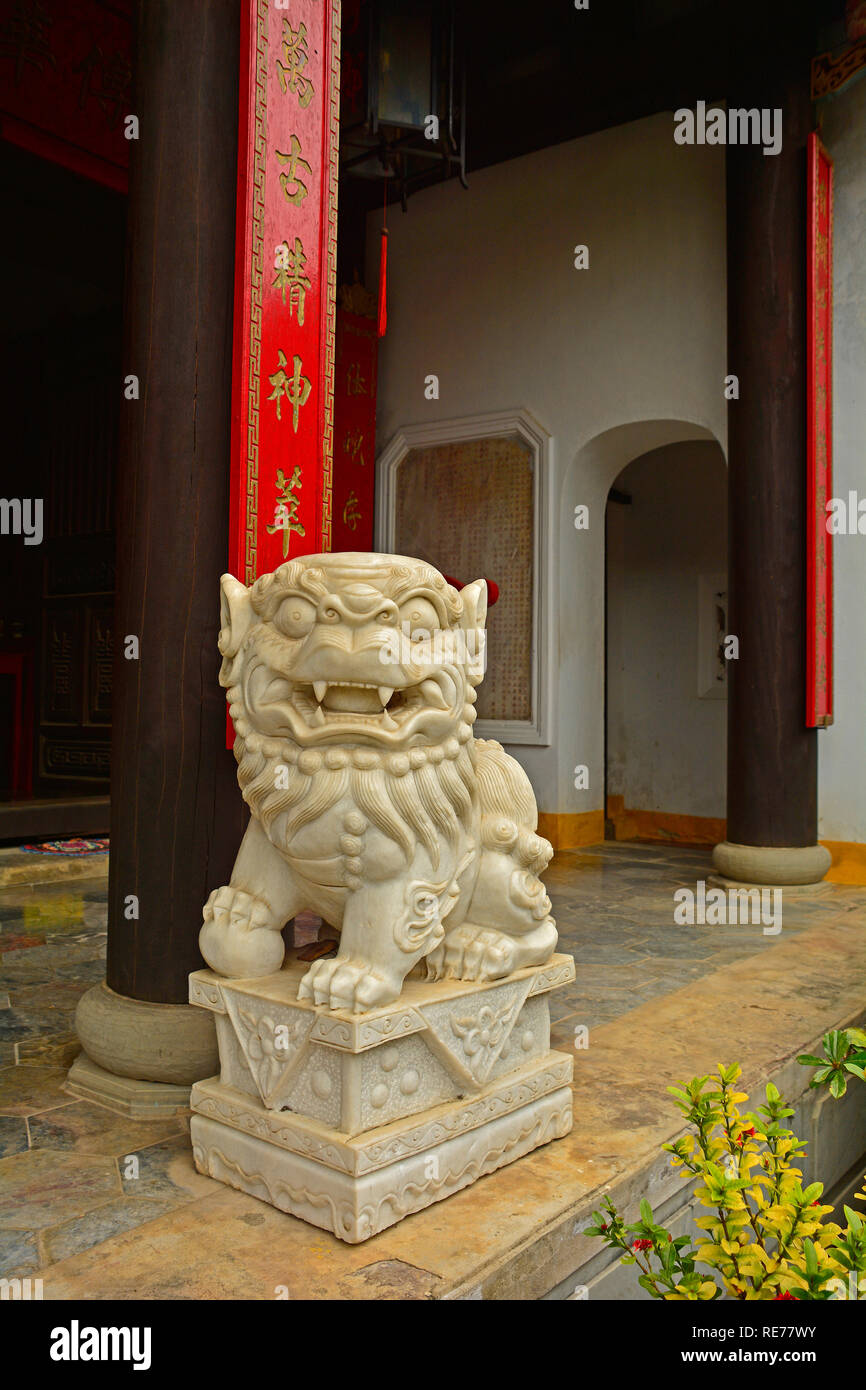 A Guardian Lion or Foo Dog at the historic Minh Huong Temple in the UNESCO listed central Vietnamese town of Hoi An - Stock Image