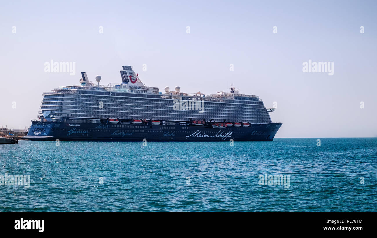 Malaga, Spain - August 28, 2018. Mein Schiff 5 cruise ship, owned and operated by TUI AG and Royal Caribbean Cruises Ltd, docked at the port of Malaga - Stock Image