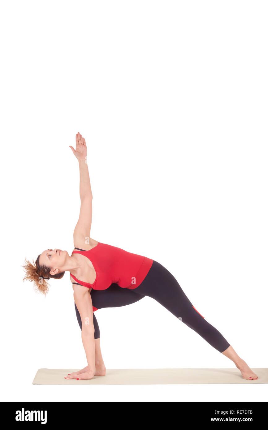 Beautiful Yoga: Half Moon Pose - Real senior sporty woman doing Ardha Chandrasana exercise - Stock Image