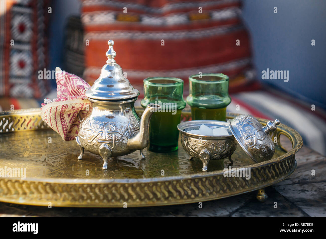 Arabian Mint Tea (Moroccan Mint Tea) The national hot drink in the Middle East and the Muslim world. Served in a special iron silver teapot with sugar - Stock Image