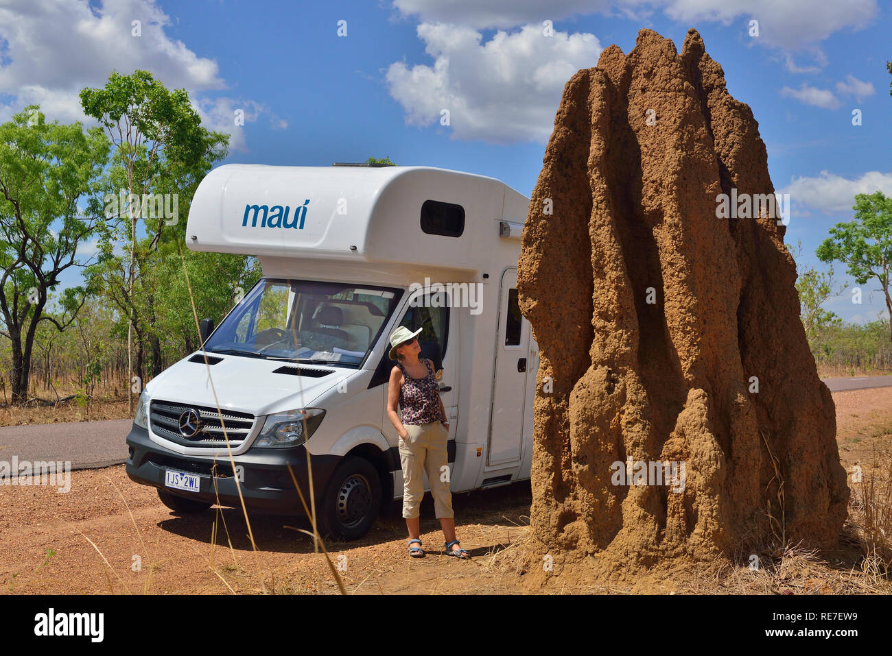 Motorhome tourist stops on the road side to look at a cathedral termite mound one of most iconic sites in Kakadu Northern Territories Australia Stock Photo