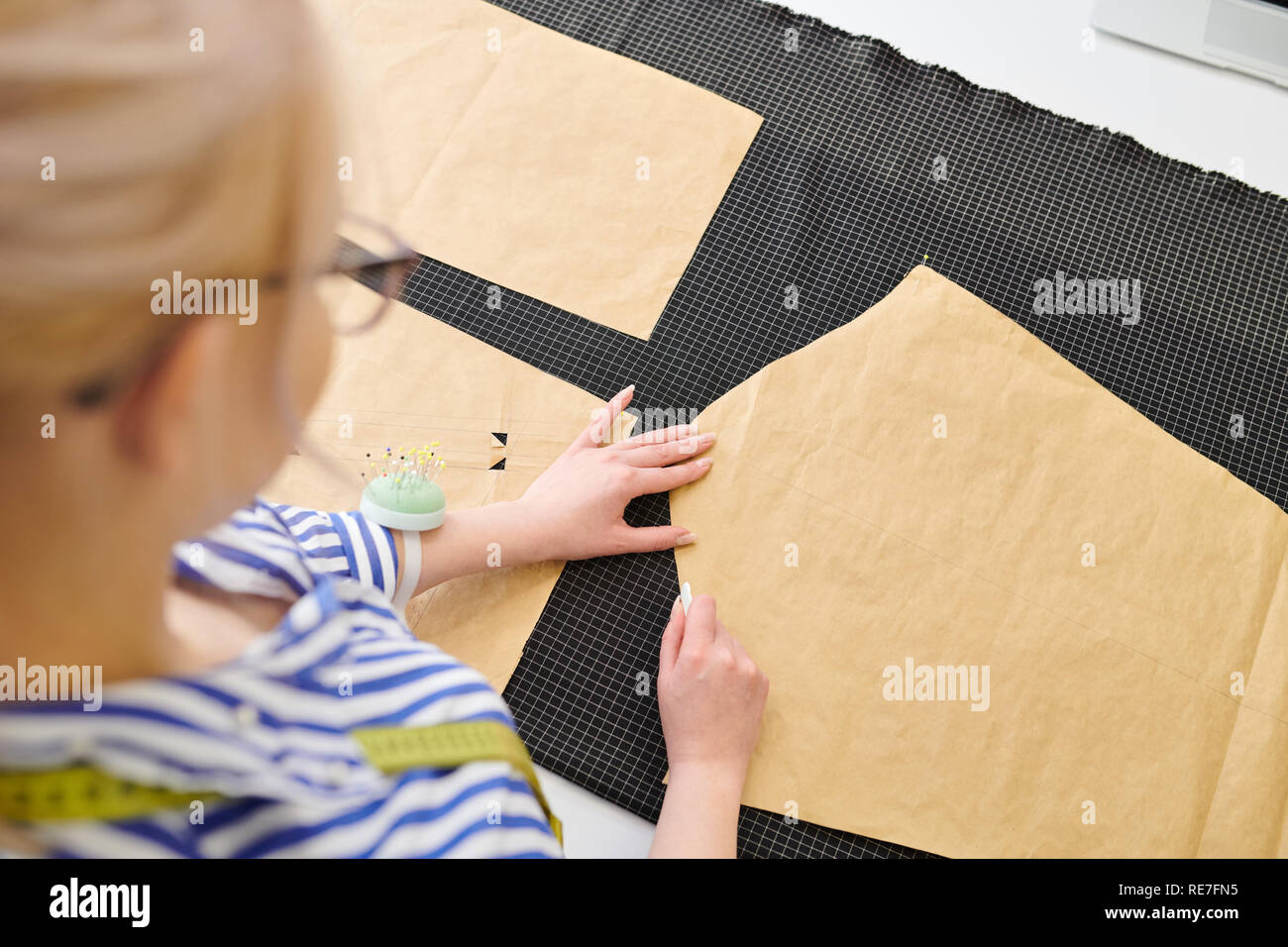 Young Fashion Designer Making White Chalk Markings Of Paper Patterns On Fabric Before Cutting Details For Future Jacket Or Costume Stock Photo Alamy