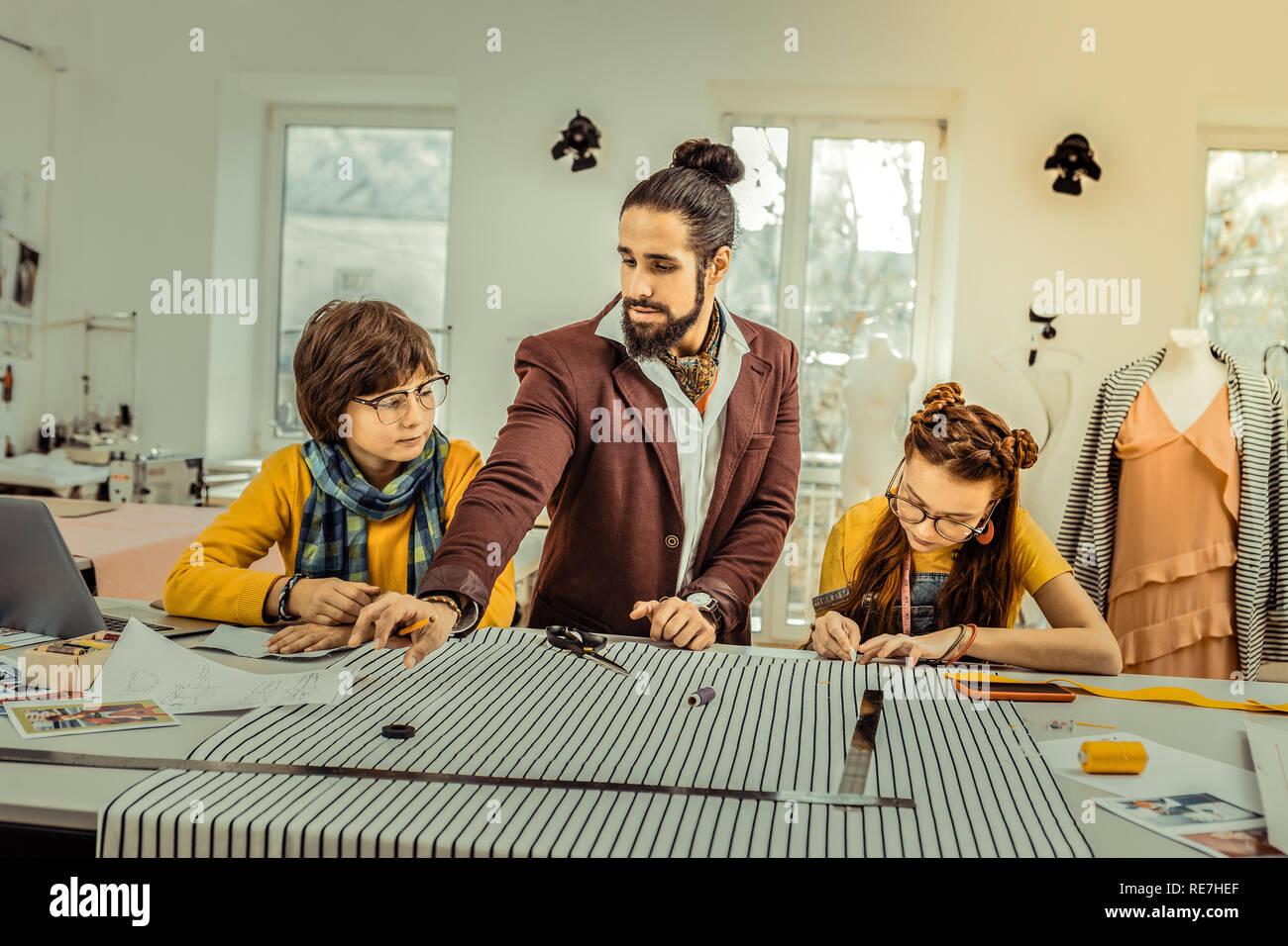 Stylish Male Fashion Designer Wearing Nice Scarf Teaching Children Stock Photo Alamy