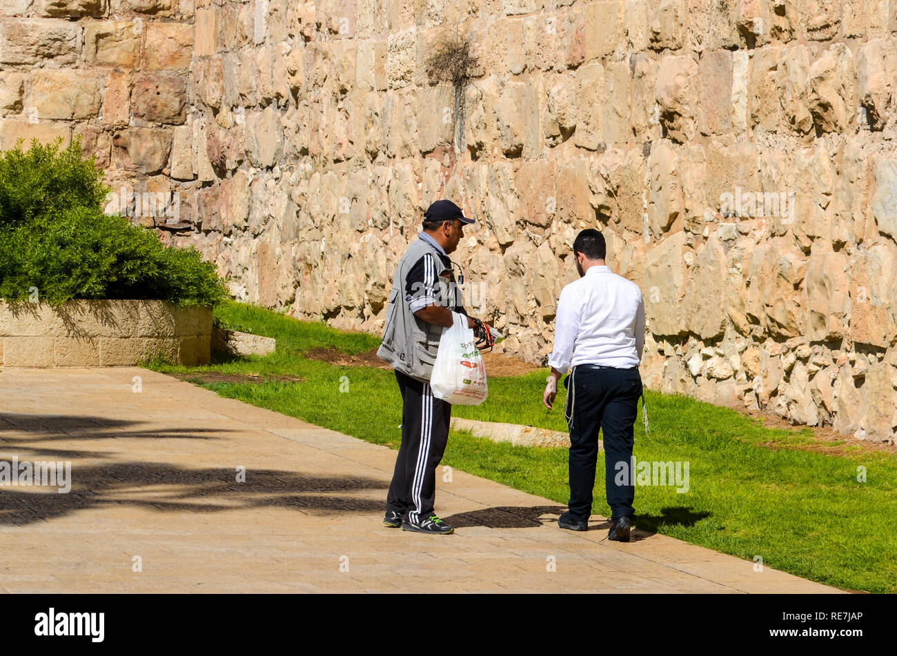 Two men by the City Walls of Jerusalem - Stock Image