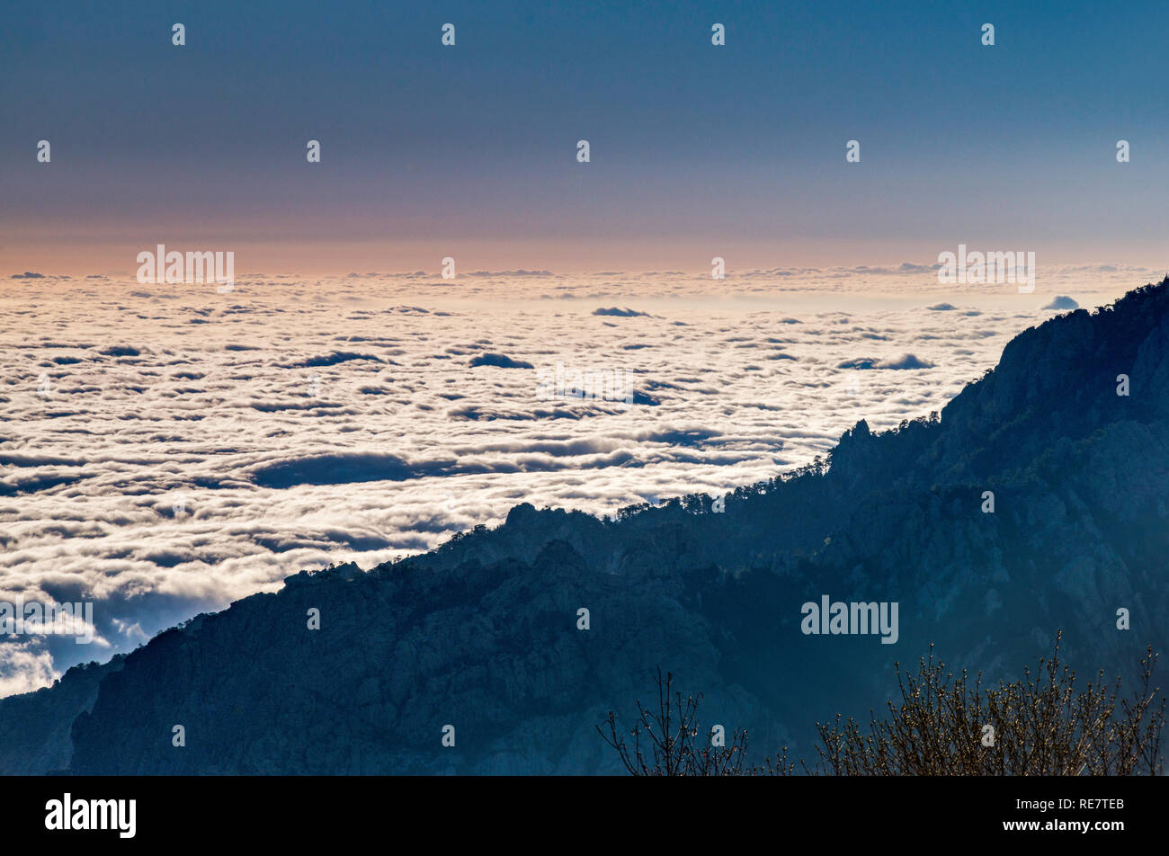Low clouds over Fium Orbo valley, early morning, view from Gite d'etape U Fugone, mountain hut at Monte Renoso trailhead, Haute-Corse, Corsica, France Stock Photo