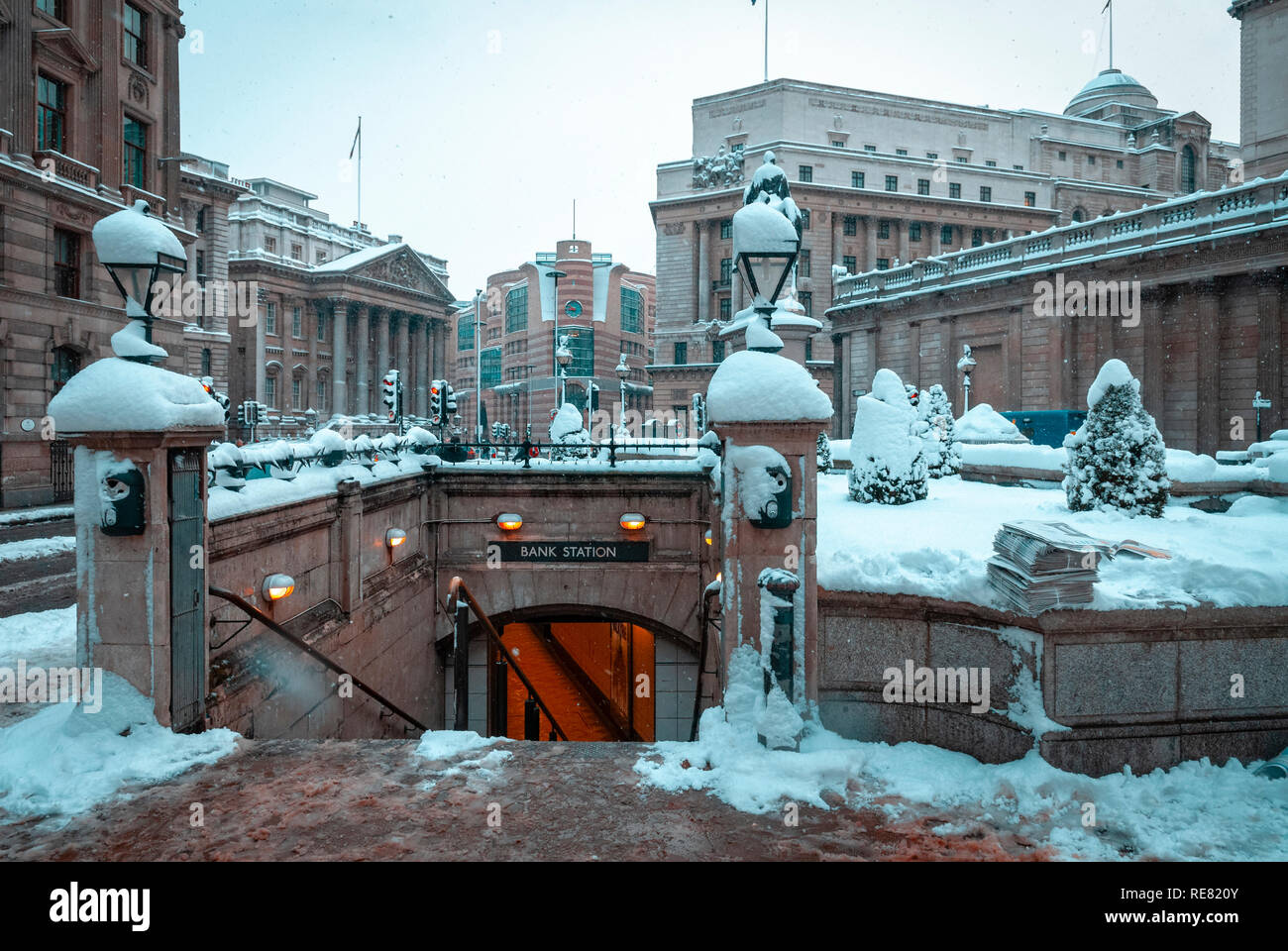 Snow covered entrance to Bank Underground station - Stock Image