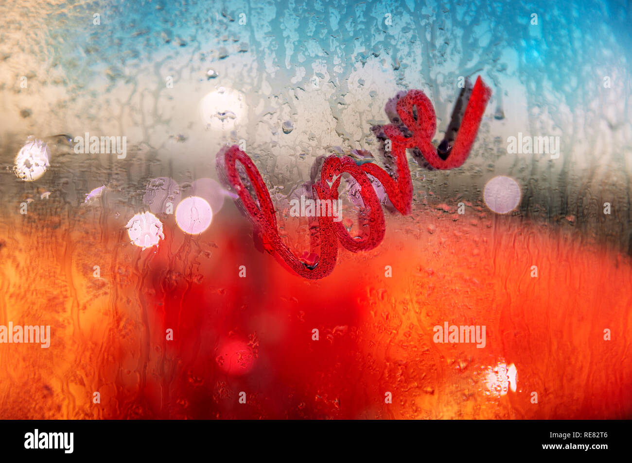 Love message, word love written in red lipstick on wet from