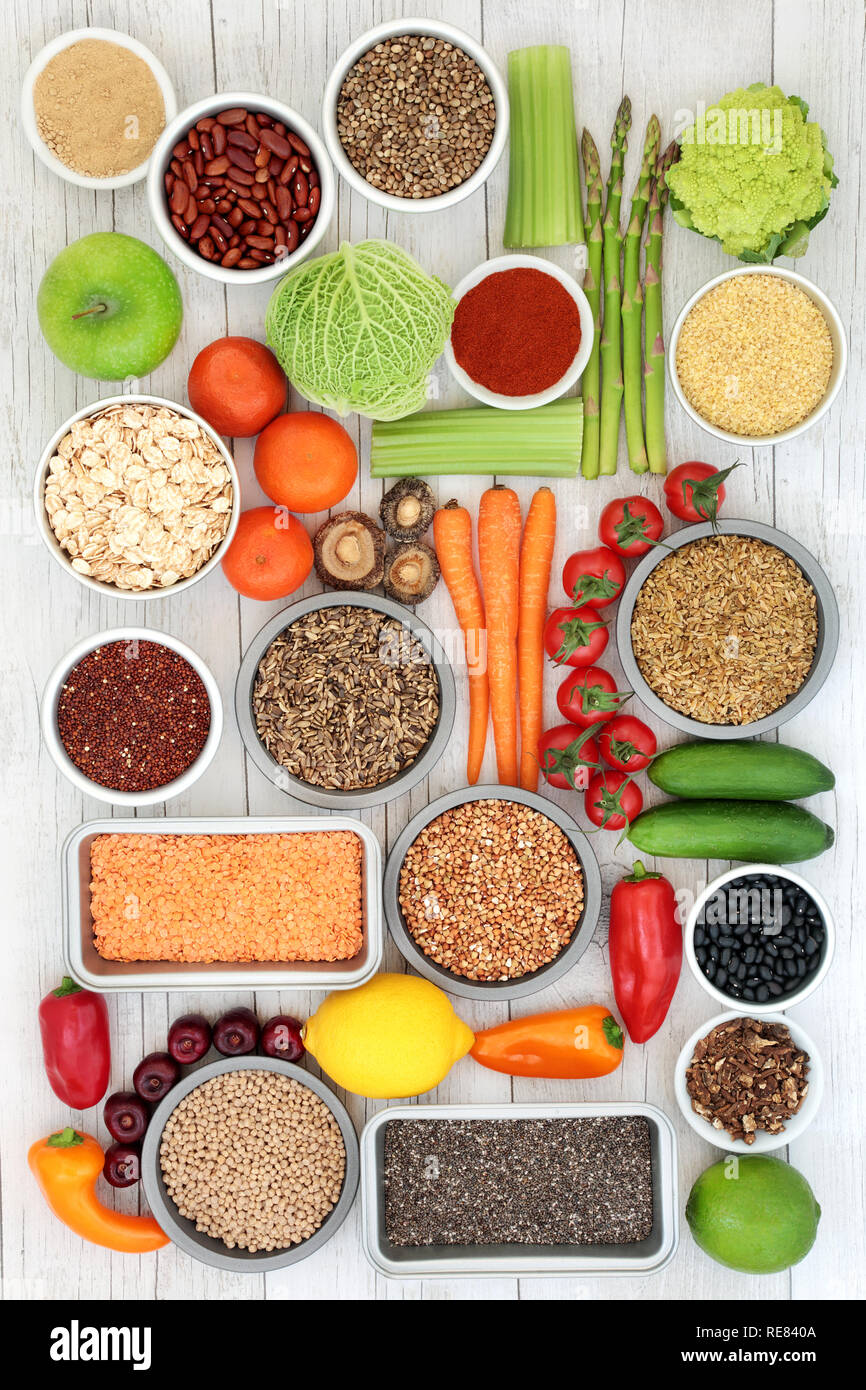 Food to detox the liver concept with fresh fruit, vegetables, legumes, supplement powder, cereals, grains, seeds, herbs & spices. - Stock Image