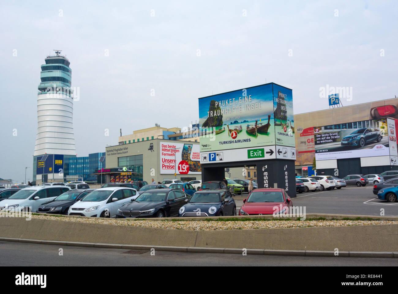 Parking lot and air control tower, Schwechat, Flughafen Wien, Vienna International airport, Vienna, Austria - Stock Image
