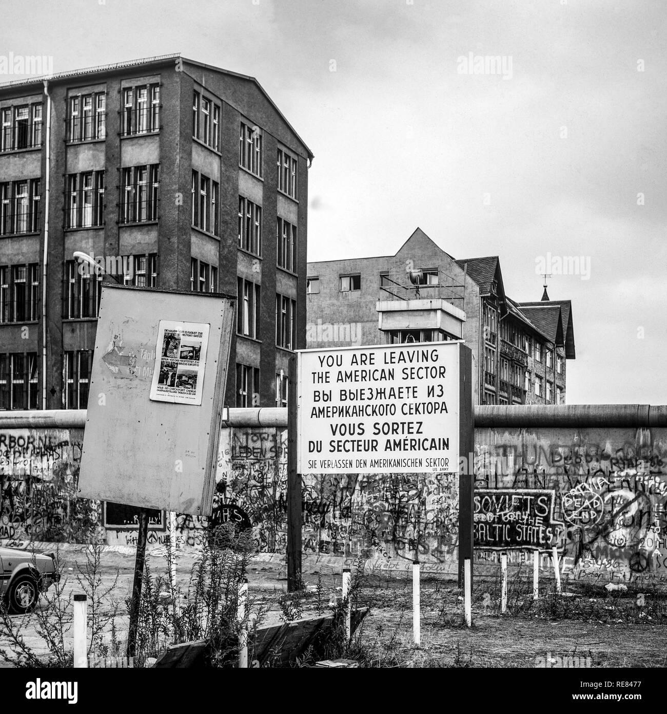 August 1986, leaving American sector warning sign, Berlin Wall graffitis, East Berlin watchtower, Zimmerstrasse street, West Berlin, Germany, Europe, - Stock Image