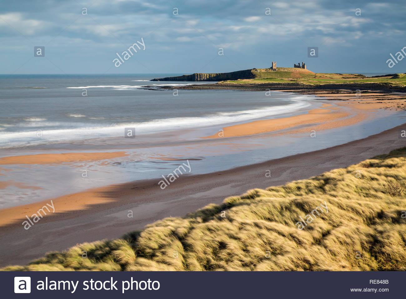 Dunstanburgh Castle and Embleton Bay, Northumberland, England - Stock Image