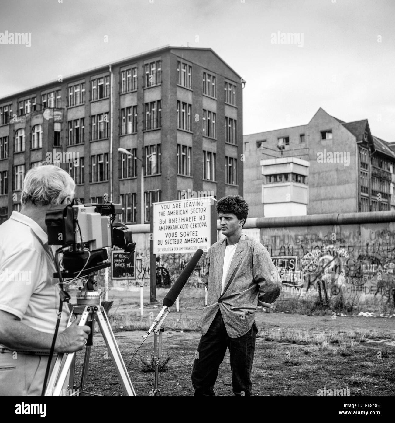 August 1986, TV interview of a former East soldier, Berlin Wall graffitis, East Berlin watchtower, Zimmerstrasse street, West Berlin, Germany, Europe, - Stock Image