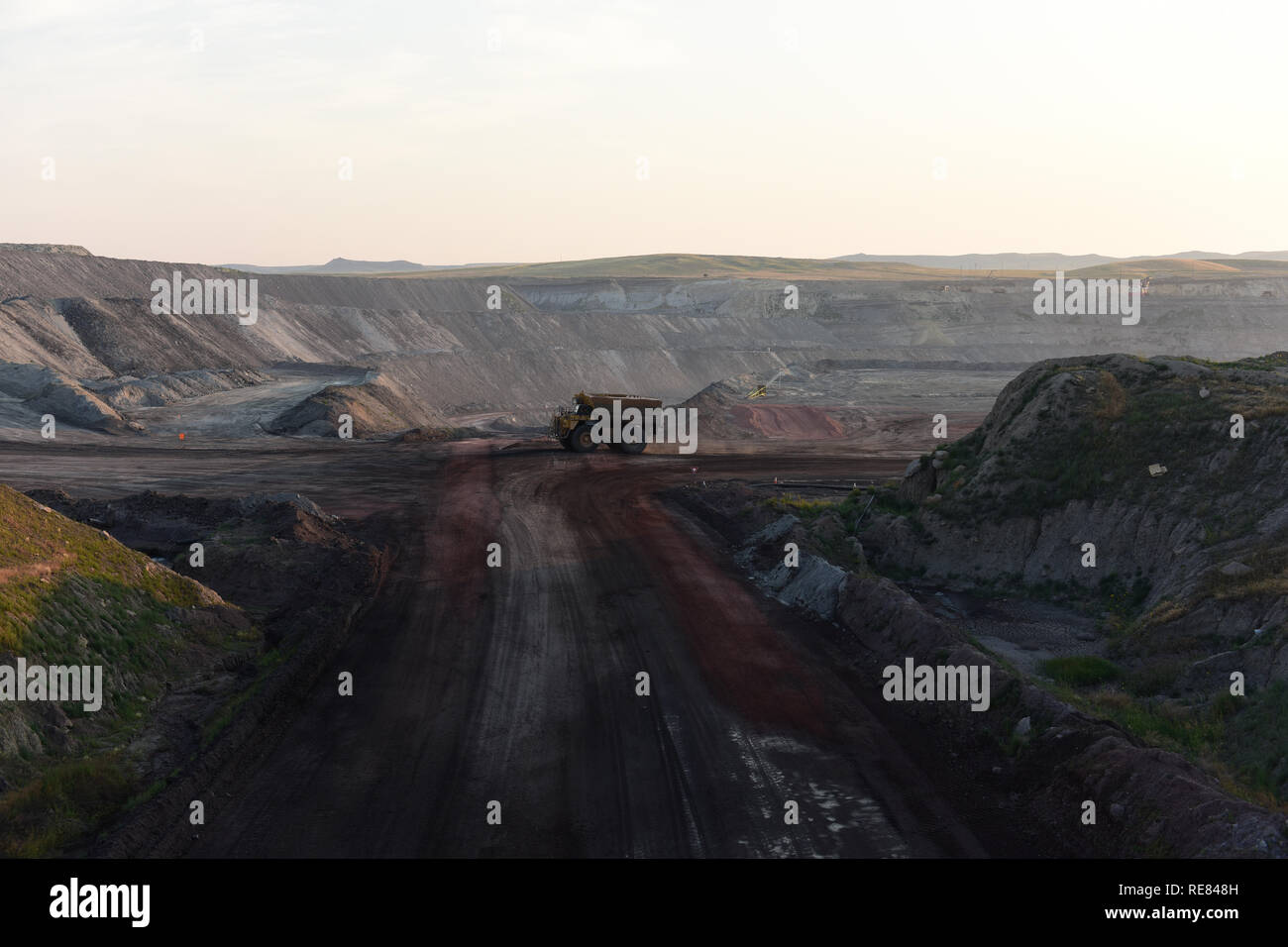 Giant size water tank truck driving on a road inside a large open pit coal mine in the Powder River Basin of Wyoming. Stock Photo