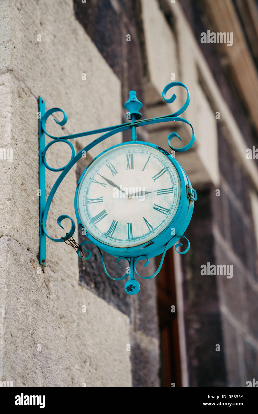 The vintage city clock in the street on a warm sunny day. - Stock Image