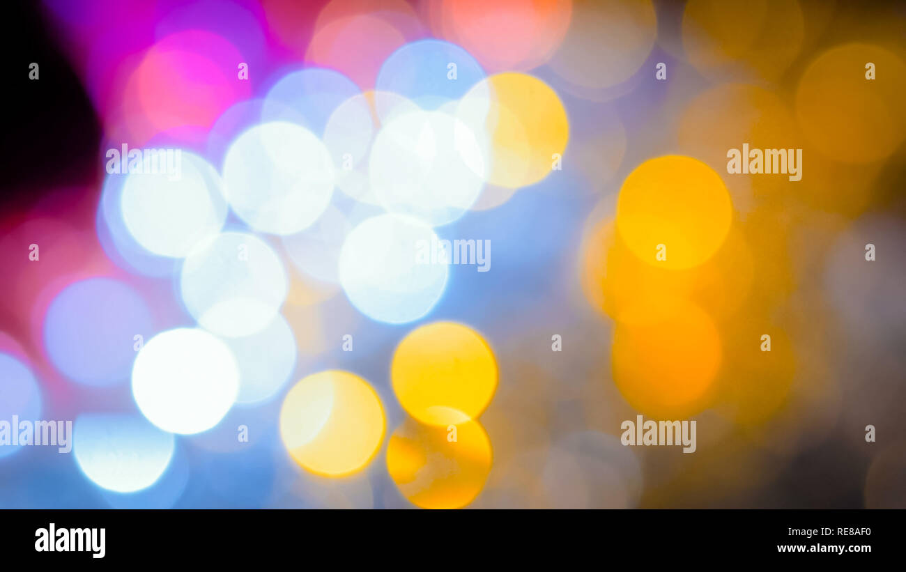 Christmas abstract garlands bokeh background. Holiday, celebration and new year concept - Stock Image