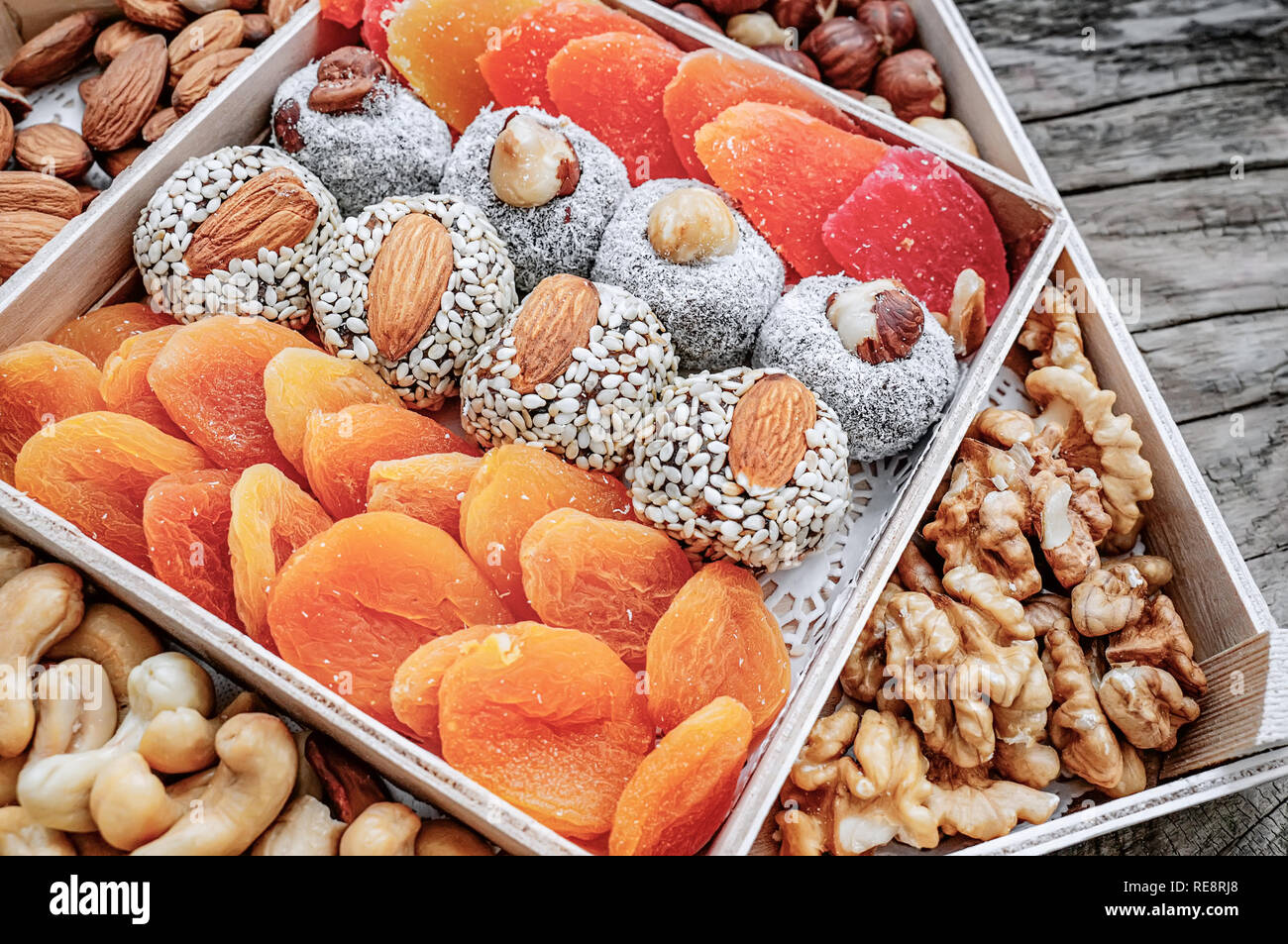 Turkish delight oriental sweets dried fruits and nuts in a wooden box. Background. Healthy vegan food. Natural food. Selective focus. Stock Photo